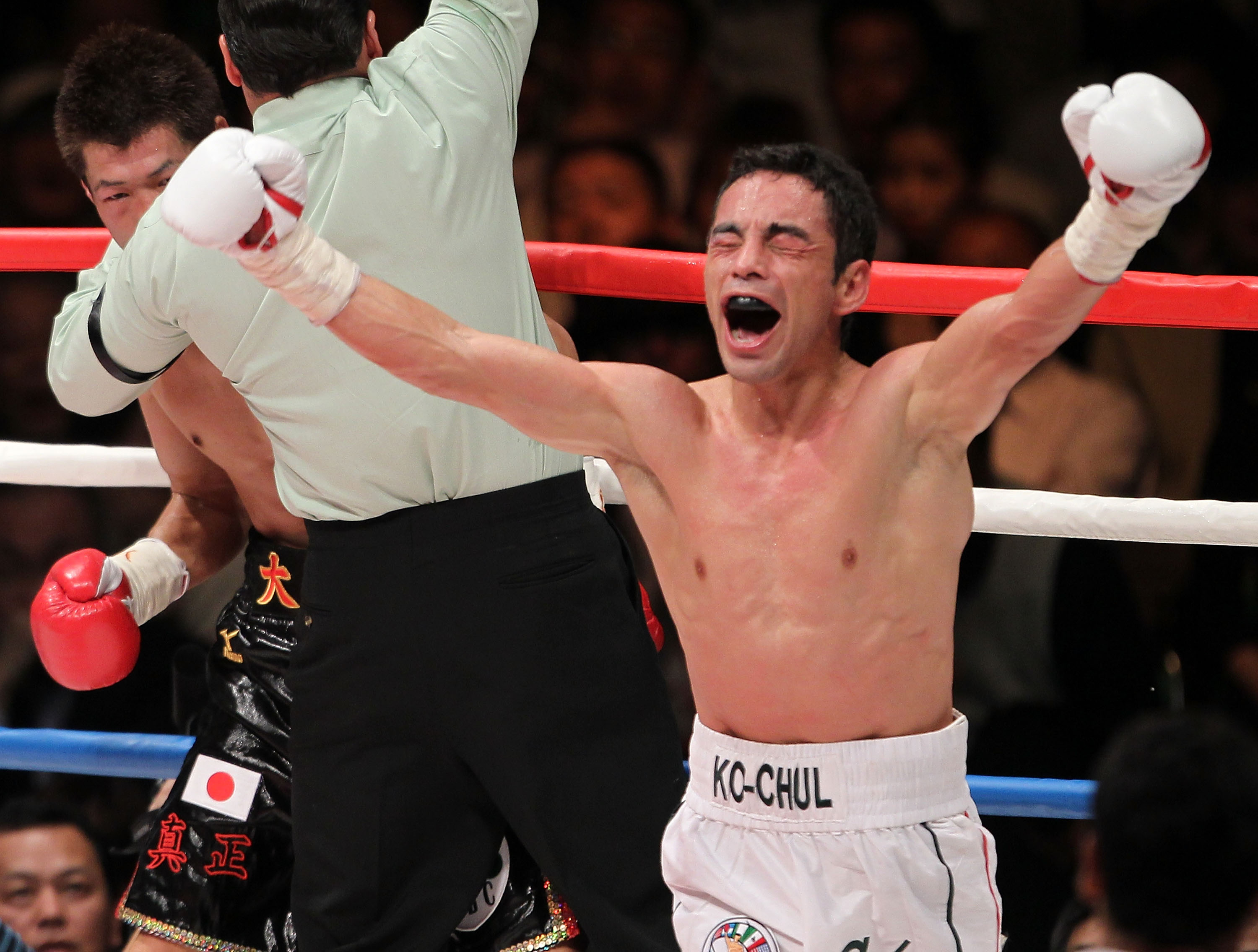 TOKYO - APRIL 30:  Fernando Montiel of Mexico celebrates after knocking out Hozumi Hasegawa of Japan during the WBC Bantamweight Title Fight between Hozumi Hasegawa and Fernando Montiel at Nippon Budokan on April 30, 2010 in Tokyo, Japan.  (Photo by Koich