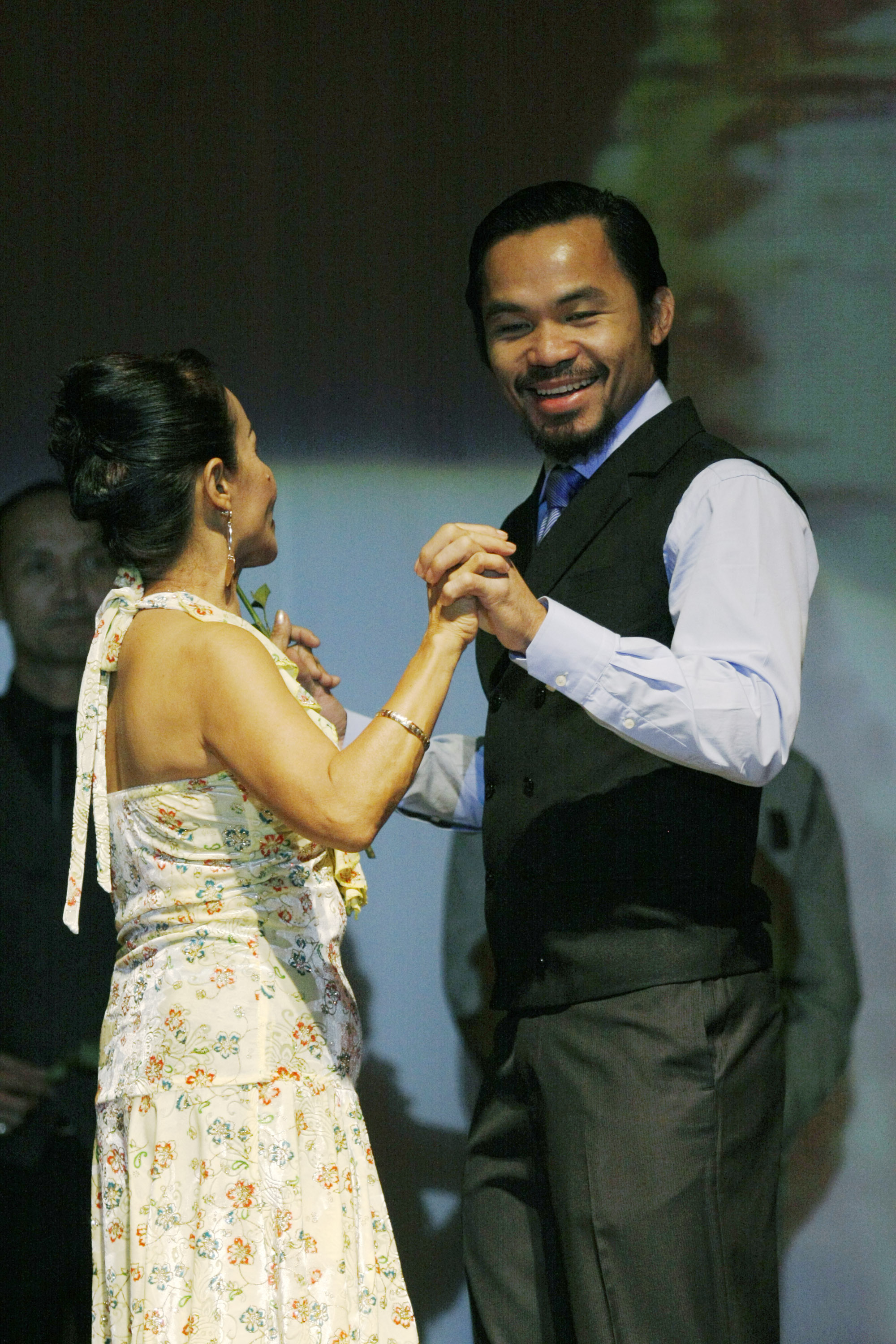 GENERAL SANTOS, PHILIPPINES - MAY 15:  World welterweight boxing champion Manny Pacquiao is seen with his mother Dionisia Pacquiao at the KCC Mall on May 15, 2010 in General Santos, Philippines. Pacquiao was there to celebrate his election on becoming a m
