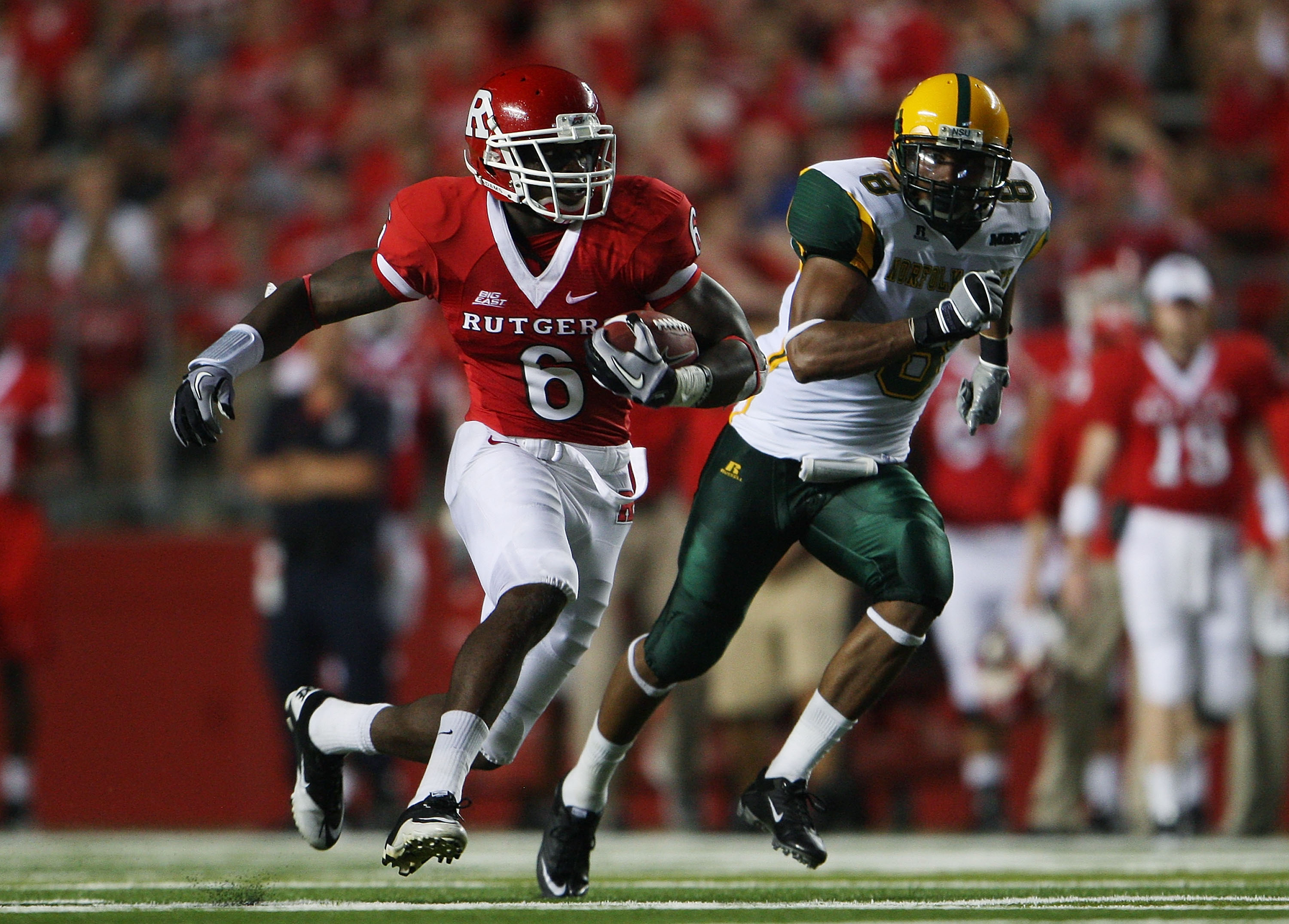 NEW BRUNSWICK, NJ - SEPTEMBER 02:  Mohamed Sanu #6 (L) of the Rutgers Scarlet Knights runs the ball against the Norfolk State Spartans at Rutgers Stadium on September 2, 2010 in New Brunswick, New Jersey. The Scarlet Knights beat the Spartans 31 - 0.  (Ph