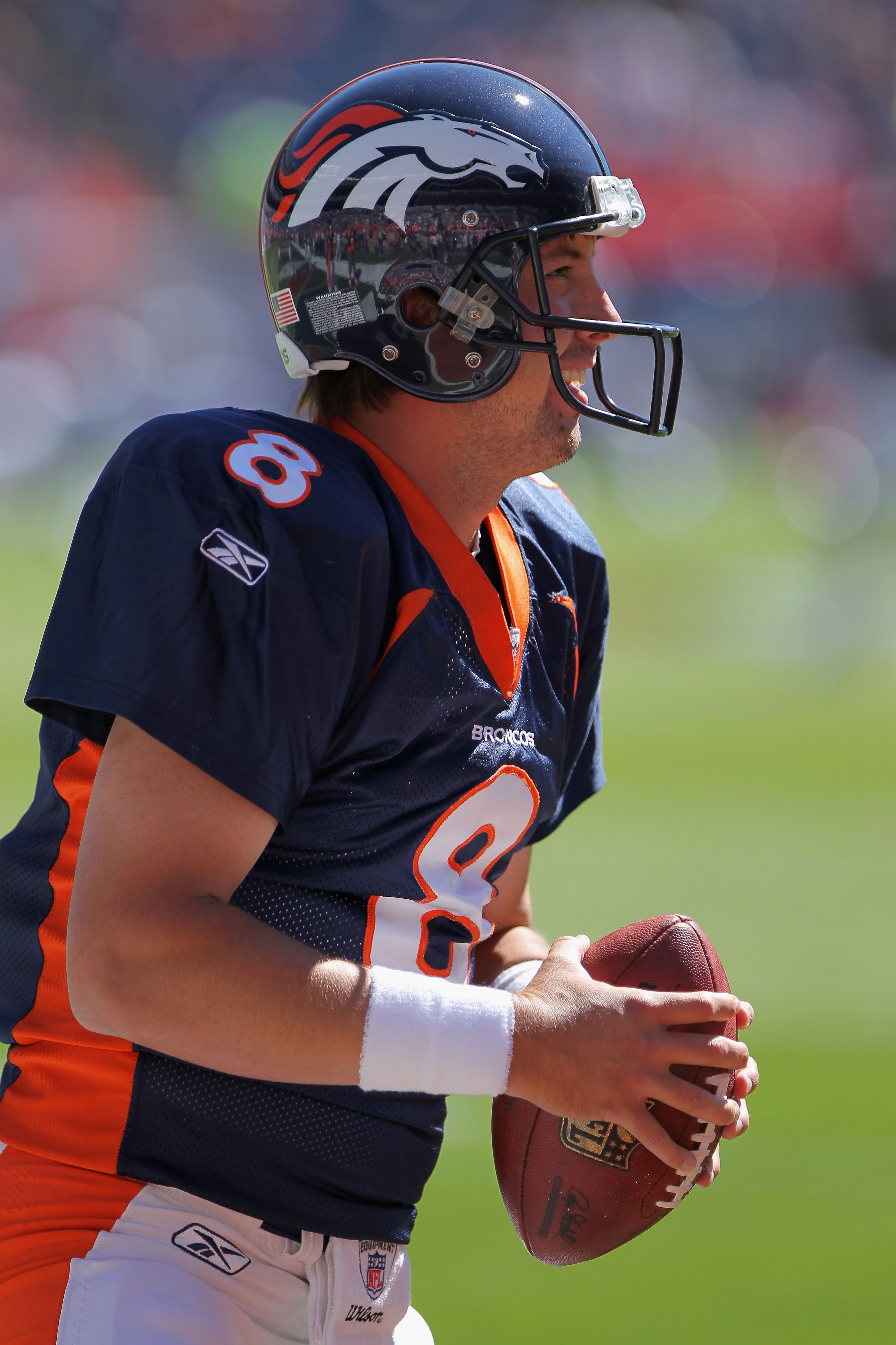 DENVER - SEPTEMBER 26:  Quarterback Kyle Orton #8 of the Denver Broncos warms up prior to facing the Indianapolis Colts at INVESCO Field at Mile High on September 26, 2010 in Denver, Colorado. Orton passed for 476 yards as the Colts defeated the Broncos 2