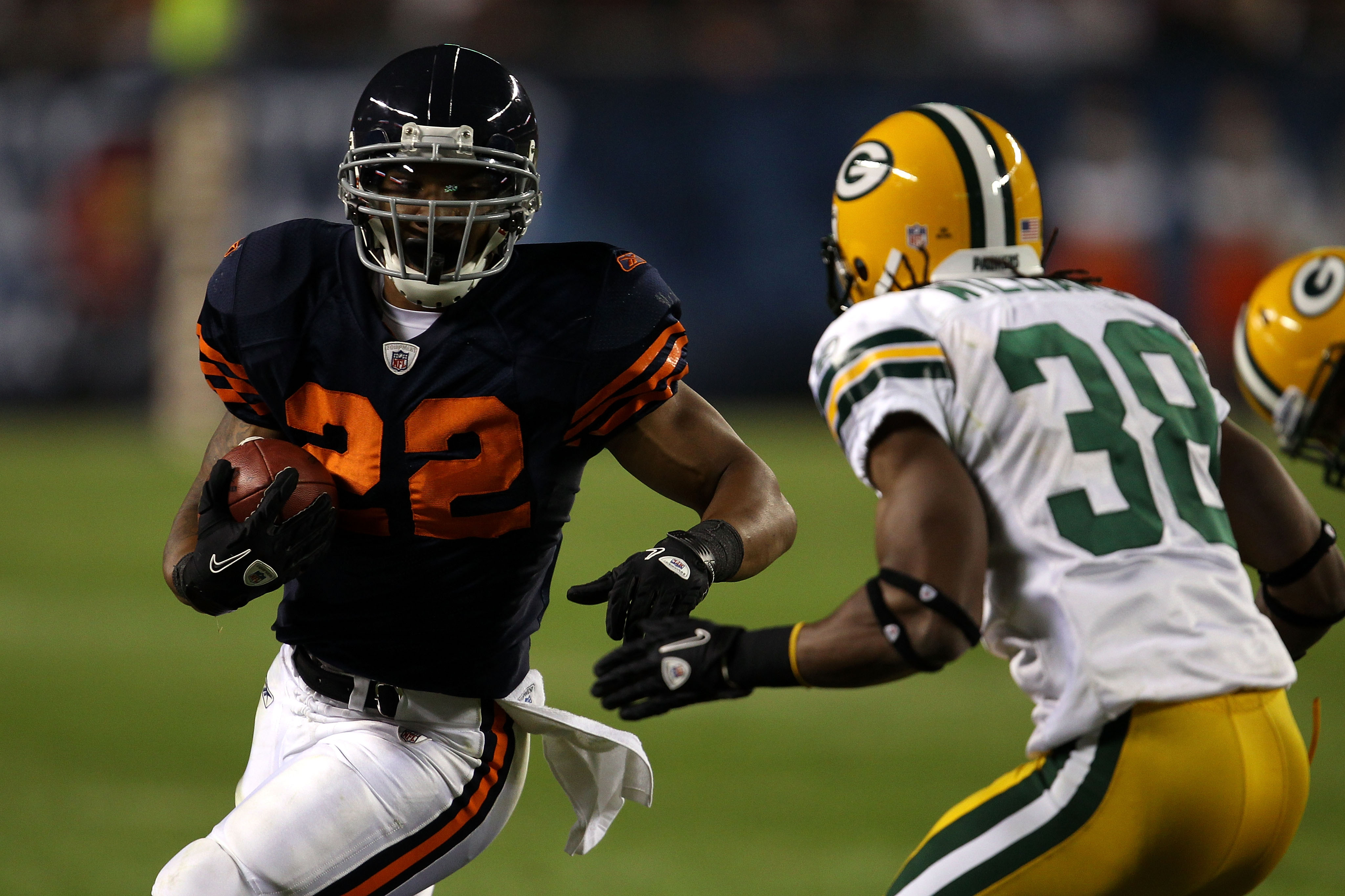 CHICAGO - SEPTEMBER 27:  Matt Forte #22 of the Chicago Bears runs the ball against Tramon Williams #38 of the Green Bay Packers at Soldier Field on September 27, 2010 in Chicago, Illinois.  (Photo by Jonathan Daniel/Getty Images)