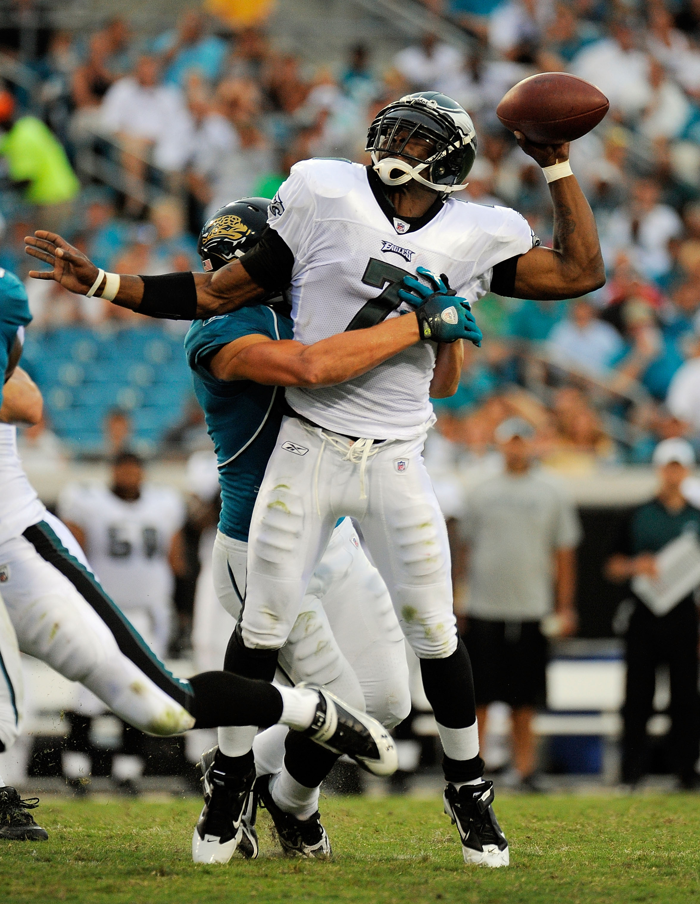 JACKSONVILLE, FL - SEPTEMBER 26:  Quarterback Michael Vick #7 of the Philadelphia Eagles is sacked by safety Sean Considine #37 of the Jacksonville Jaguars at EverBank Field on September 26, 2010 in Jacksonville, Florida. The Eagles defeated the Jaguars 2