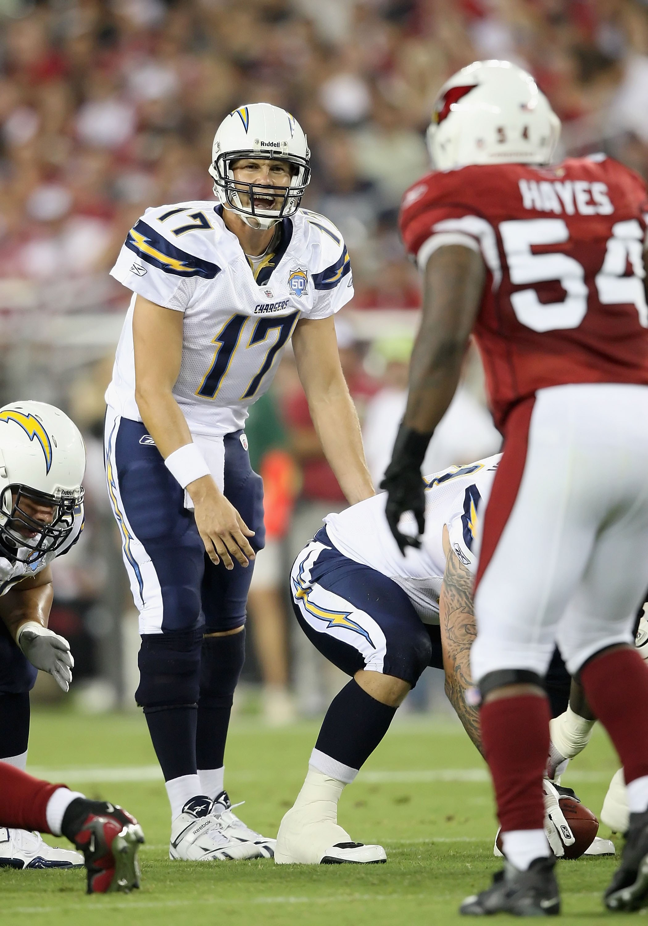 GLENDALE, AZ - AUGUST 22:  Quarterback Philip Rivers #17 of the San Diego Chargers prepares to snap the ball during the NFL game against the Arizona Cardinals at the University of Phoenix Stadium on August 22, 2009 in Glendale, Arizona. The Chargers defea