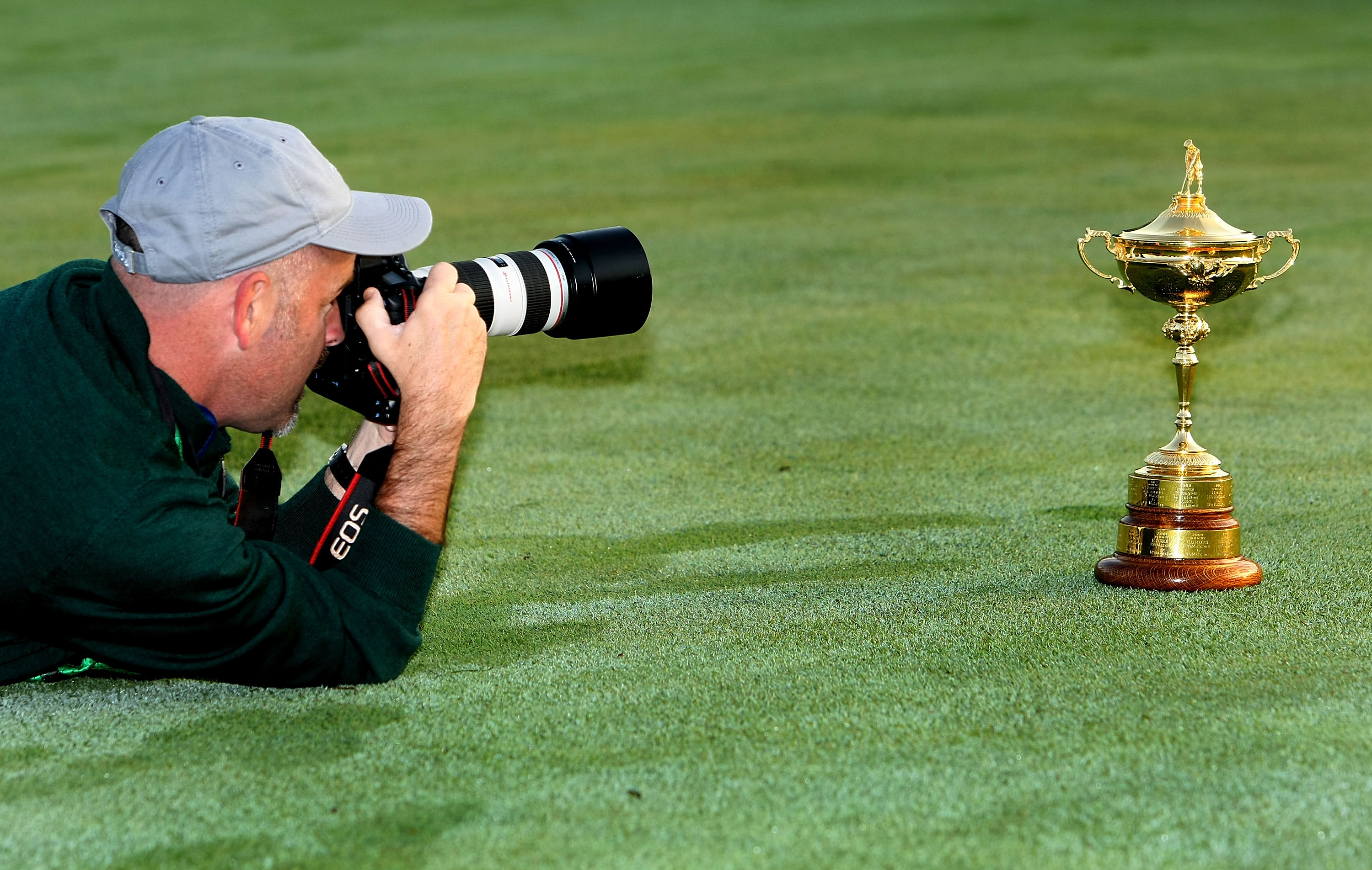 LOUISVILLE, KY - SEPTEMBER 16:  A photographer takes a close up picture of the Ryder Cup during the European team photo shoot prior to the start of the 2008 Ryder Cup at Valhalla Golf Club on September 16, 2008 in Louisville, Kentucky.  (Photo by Harry Ho