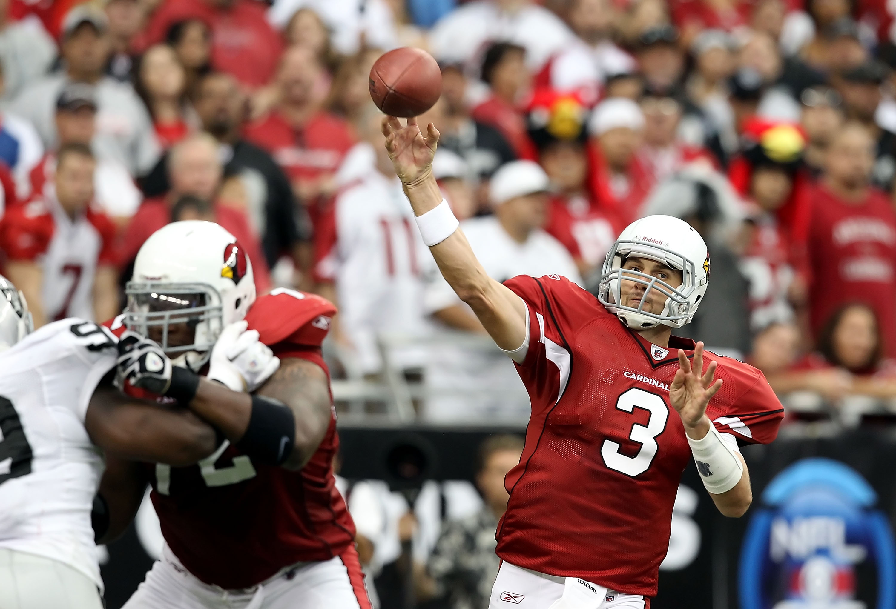 GLENDALE, AZ - SEPTEMBER 26:  Quarterback Derek Anderson #3 of the Arizona Cardinals throws a pass during the NFL game against the Oakland Raiders at the University of Phoenix Stadium on September 26, 2010 in Glendale, Arizona.  The Cardinals defeated the