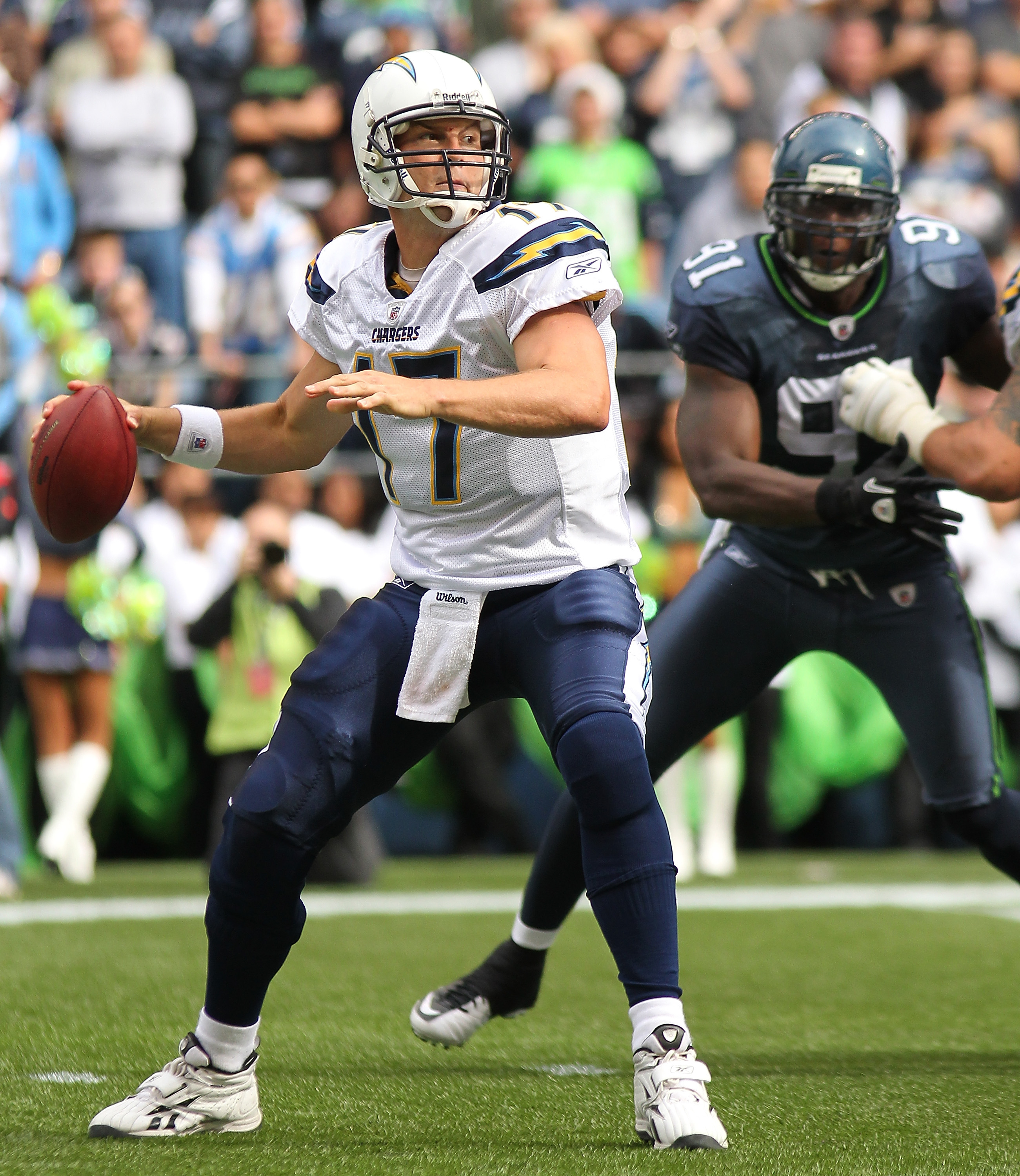 SEATTLE - SEPTEMBER 26:  Quarterback Philip Rivers #17 of the San Diego Chargers passes under pressure from Chris Clemons #91 of the Seattle Seahawks at Qwest Field on September 26, 2010 in Seattle, Washington. The Seahawks defeated the Chargers 27-20.(Ph