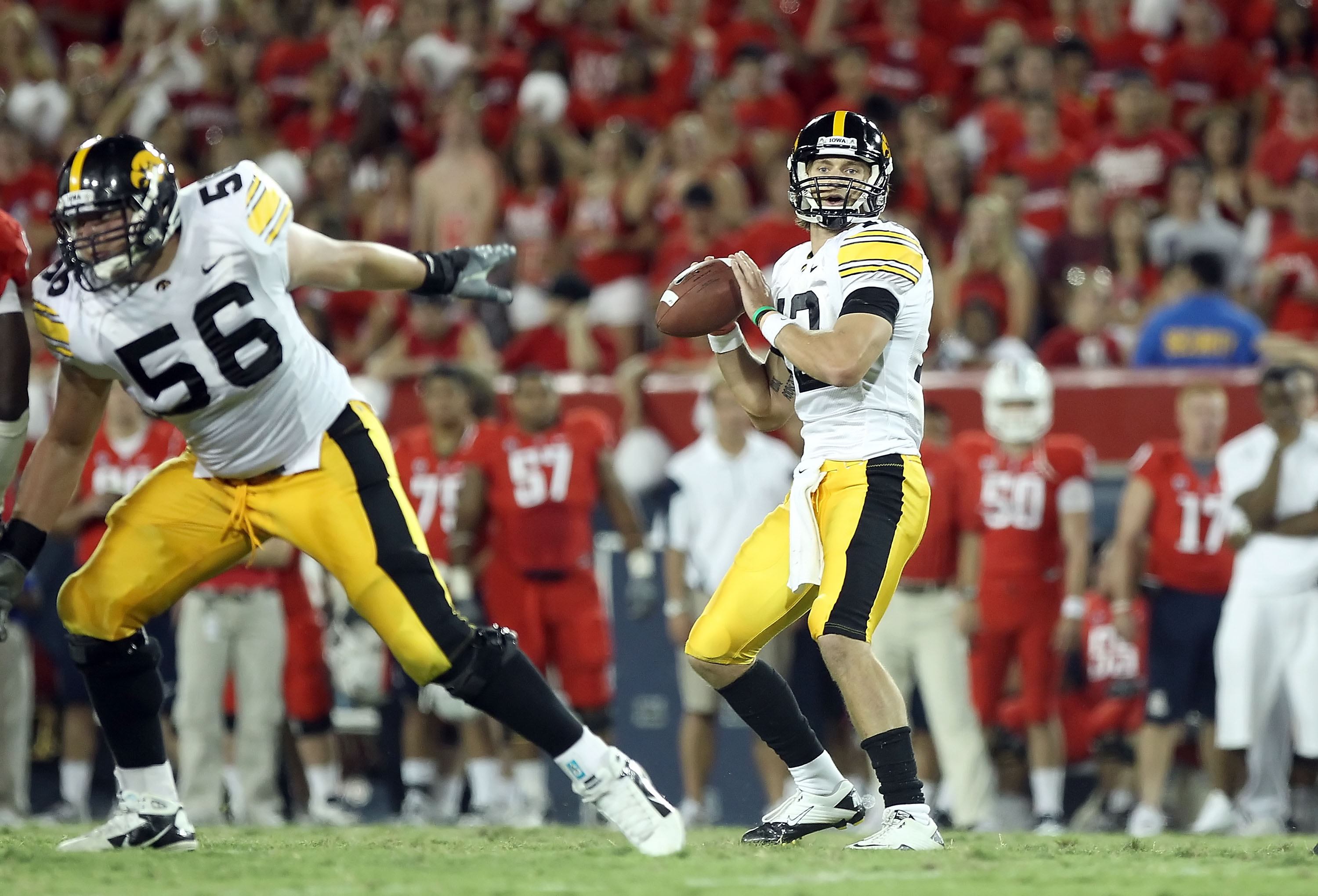 TUCSON, AZ - SEPTEMBER 18:  Quarterback Ricky Stanzi #12 of the Iowa Hawkeyes drops back to pass during the college football game against the Arizona Wildcats at Arizona Stadium on September 18, 2010 in Tucson, Arizona.  The Wildcats defeated the Hawkeyes