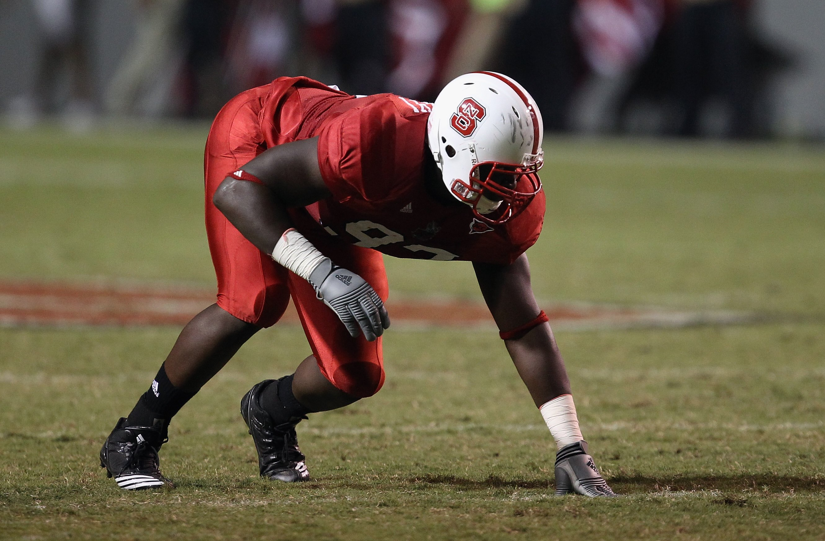 RALEIGH, NC - SEPTEMBER 16:  David Akinniyi #97 of the North Carolina State Wolfpack during their game at Carter-Finley Stadium on September 16, 2010 in Raleigh, North Carolina.  (Photo by Streeter Lecka/Getty Images)
