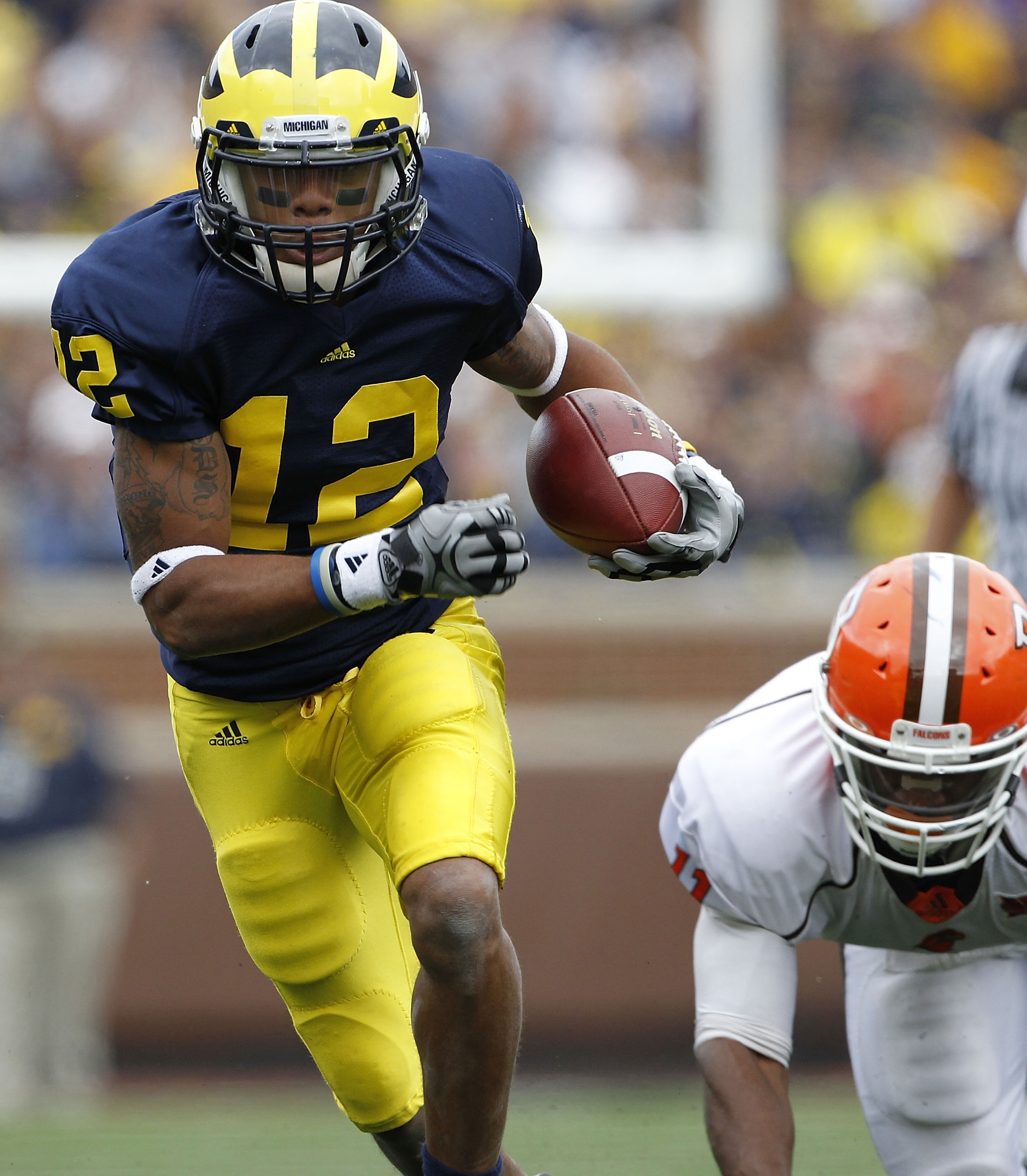 ANN ARBOR, MI - SEPTEMBER 25: Roy Roundtree #12 of the Michigan Wolverines runs for a 32 yard gain after catching the pass from Denard Robinson during the first quarter of the game against Bowling Green on September 25, 2010 at Michigan Stadium in Ann Arb