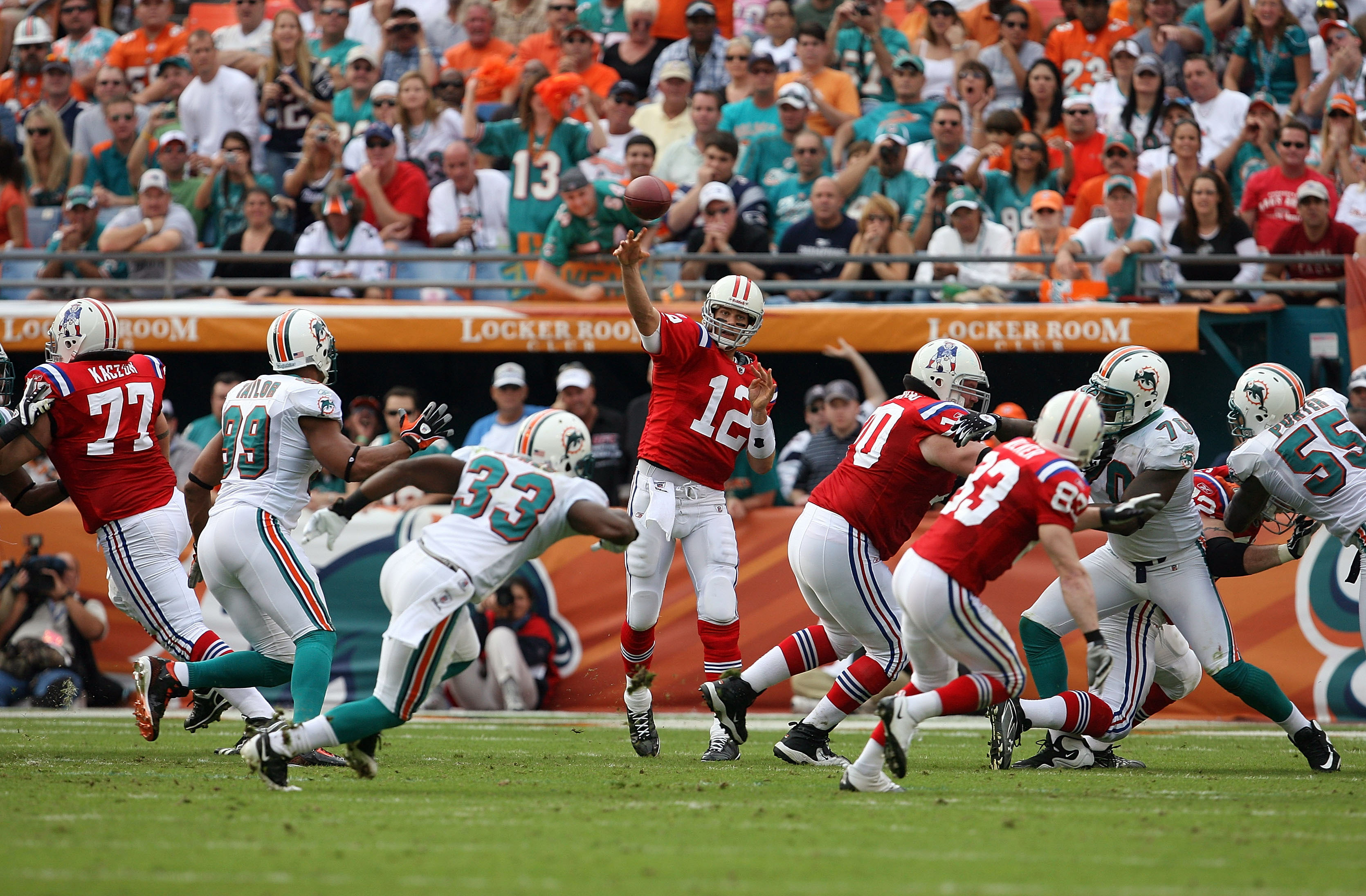 MIAMI - DECEMBER 06:  Quarterback Tom Brady #12 of the New England Patriots throws a pass against the Miami Dolphins at Land Shark Stadium on December 6, 2009 in Miami, Florida.  (Photo by Doug Benc/Getty Images)