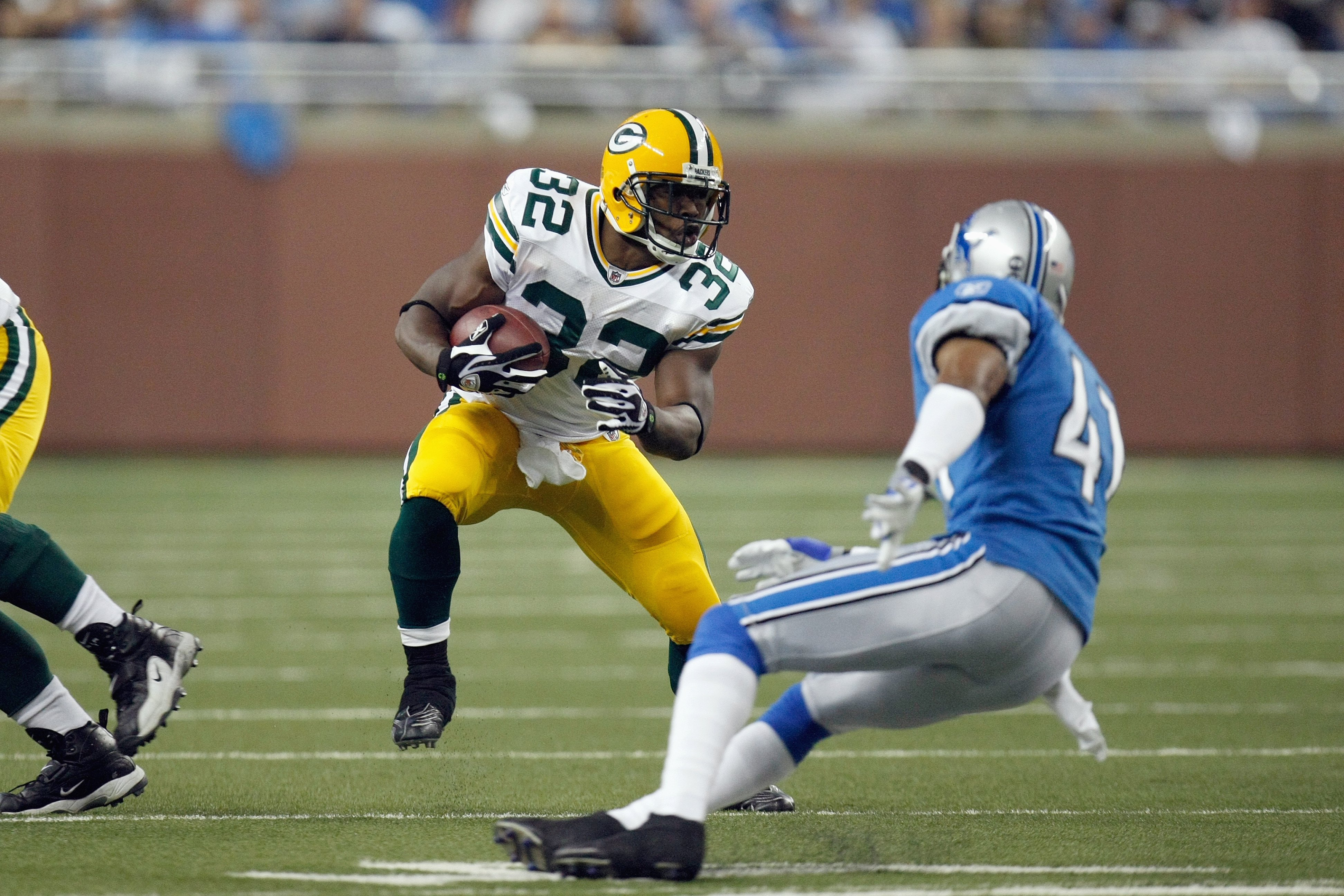 DETROIT , MI - NOVEMBER 26:  Brandon Jackson #32 of the Green Bay Packers carries the ball against the Detroit Lions on November 26, 2009 at Ford Field in Detroit, Michigan. Green Bay won the game 34-12. (Photo by Gregory Shamus/Getty Images)