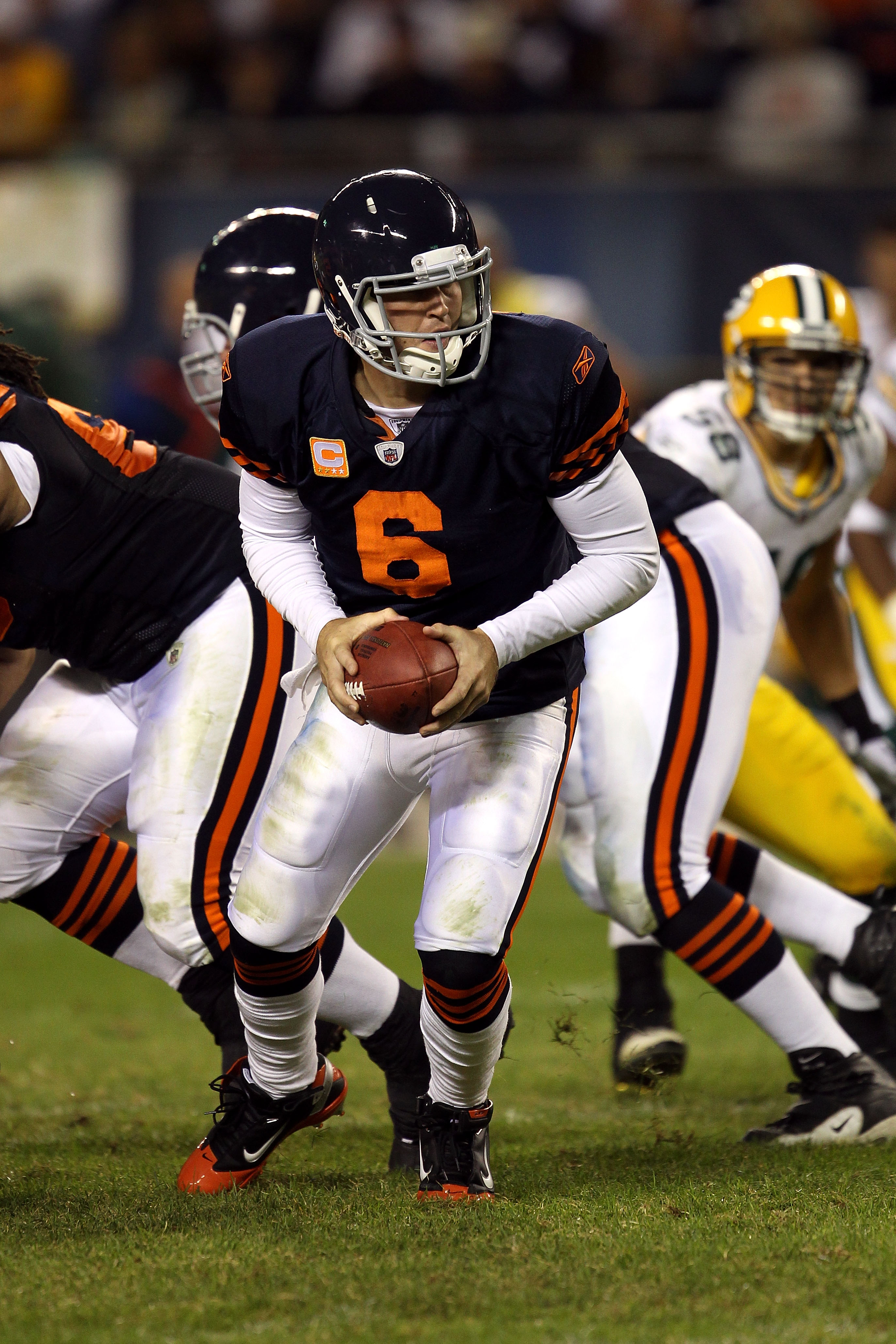 CHICAGO - SEPTEMBER 27:  Quarterback Jay Cutler #6 of the Chicago Bears turns to hand the ball off against the Green Bay Packers at Soldier Field on September 27, 2010 in Chicago, Illinois. The Bears won 20-17. (Photo by Jonathan Daniel/Getty Images)