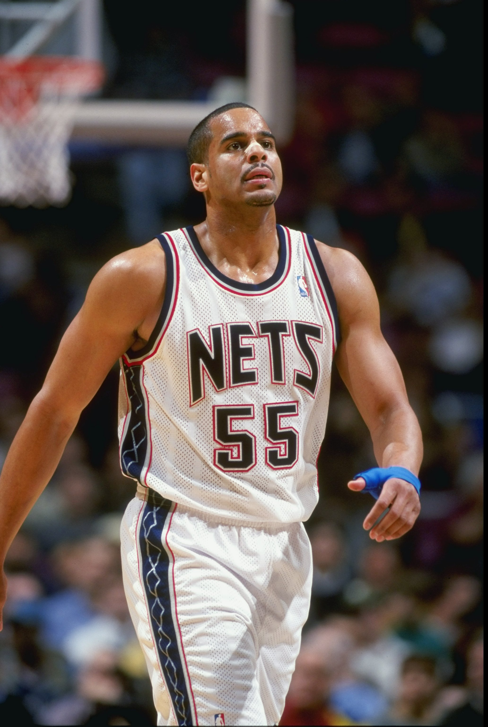 17 Mar 1999:  Jayson Williams #55 of the New Jersey Nets looking on during the game against the Dallas Mavericks at the Continental Airlines Arena in East Rutherford, New Jersey. The Nets defeated the Mavericks 88-87.