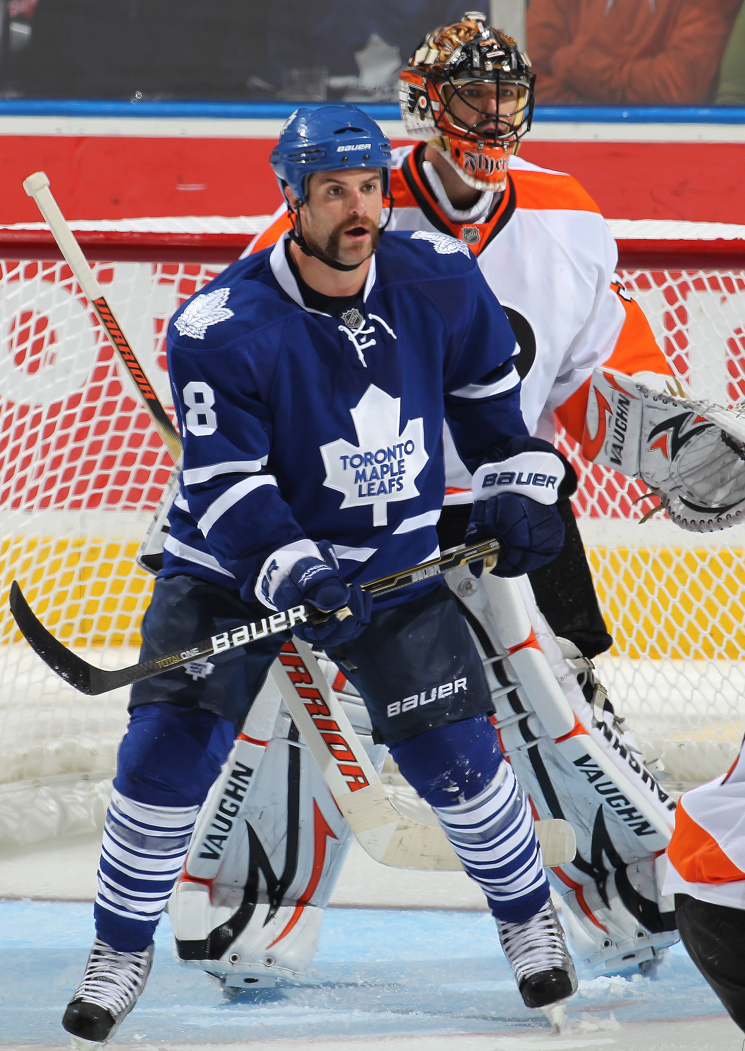 LONDON, CANADA - SEPTEMBER 23:  Mike Brown #18 of the Toronto Maple Leafs settles in the crease in front of goalie Brian Boucher #33 of the Philadelphia Flyers in a preseason game on September 23,2010 at the John Labatt Centre in London, Ontario. The Leaf