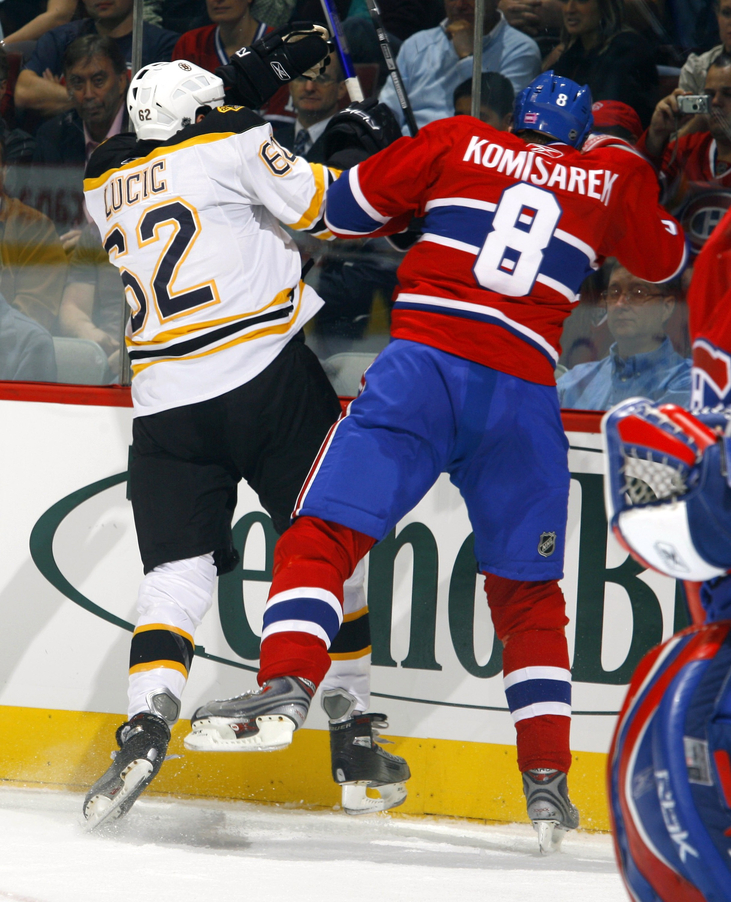 MONTREAL, CANADA - OCTOBER 22:  Milan Lucic #62 of the Boston Bruins throws a big hit on Michael Komisarek #8 of the Montreal Canadiens during first period action on October 22, 2007 at the Bell Centre in Montreal, Quebec. The Montreal Canadiens lead the