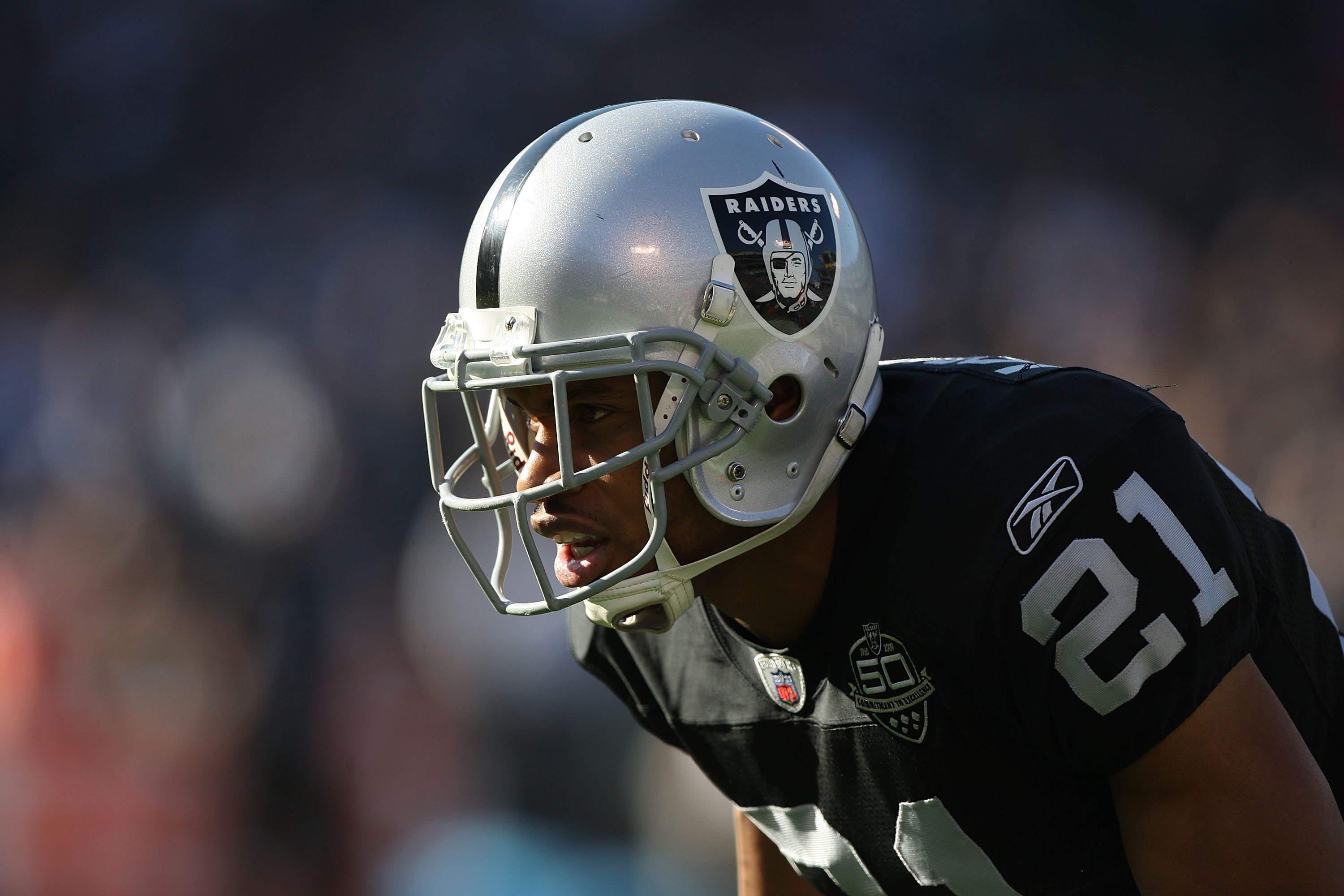 OAKLAND, CA - JANUARY 03:  Nnamdi Asomugha #21 of the Oakland Raiders in action against the Baltimore Ravens during an NFL game at Oakland-Alameda County Coliseum on January 3, 2010 in Oakland, California.  (Photo by Jed Jacobsohn/Getty Images)
