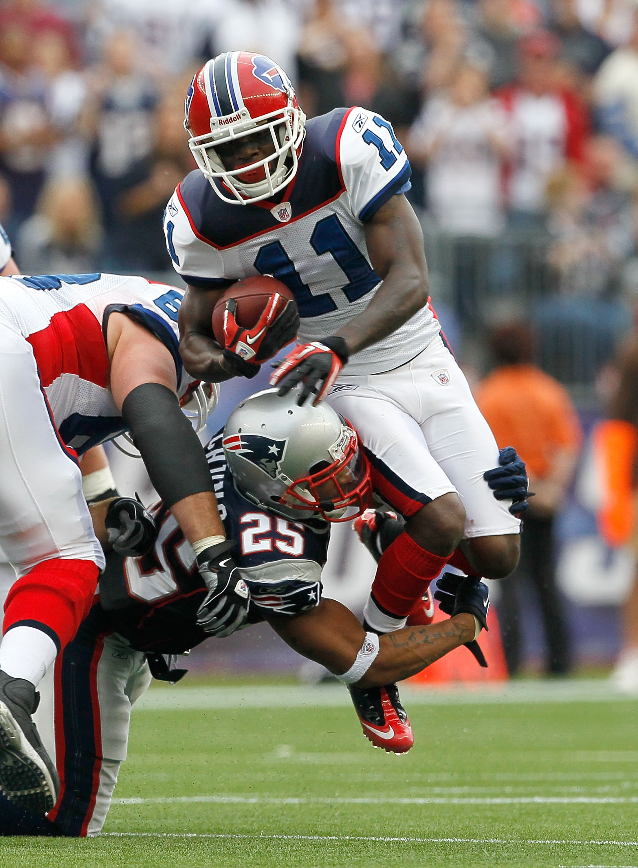 FOXBORO, MA - SEPTEMBER 26:  Patrick Chung #25 of the New England Patriots brings down Roscoe Parrish #11 of the Buffalo Bills in the second half at Gillette Stadium on September 26, 2010 in Foxboro, Massachusetts. (Photo by Jim Rogash/Getty Images)