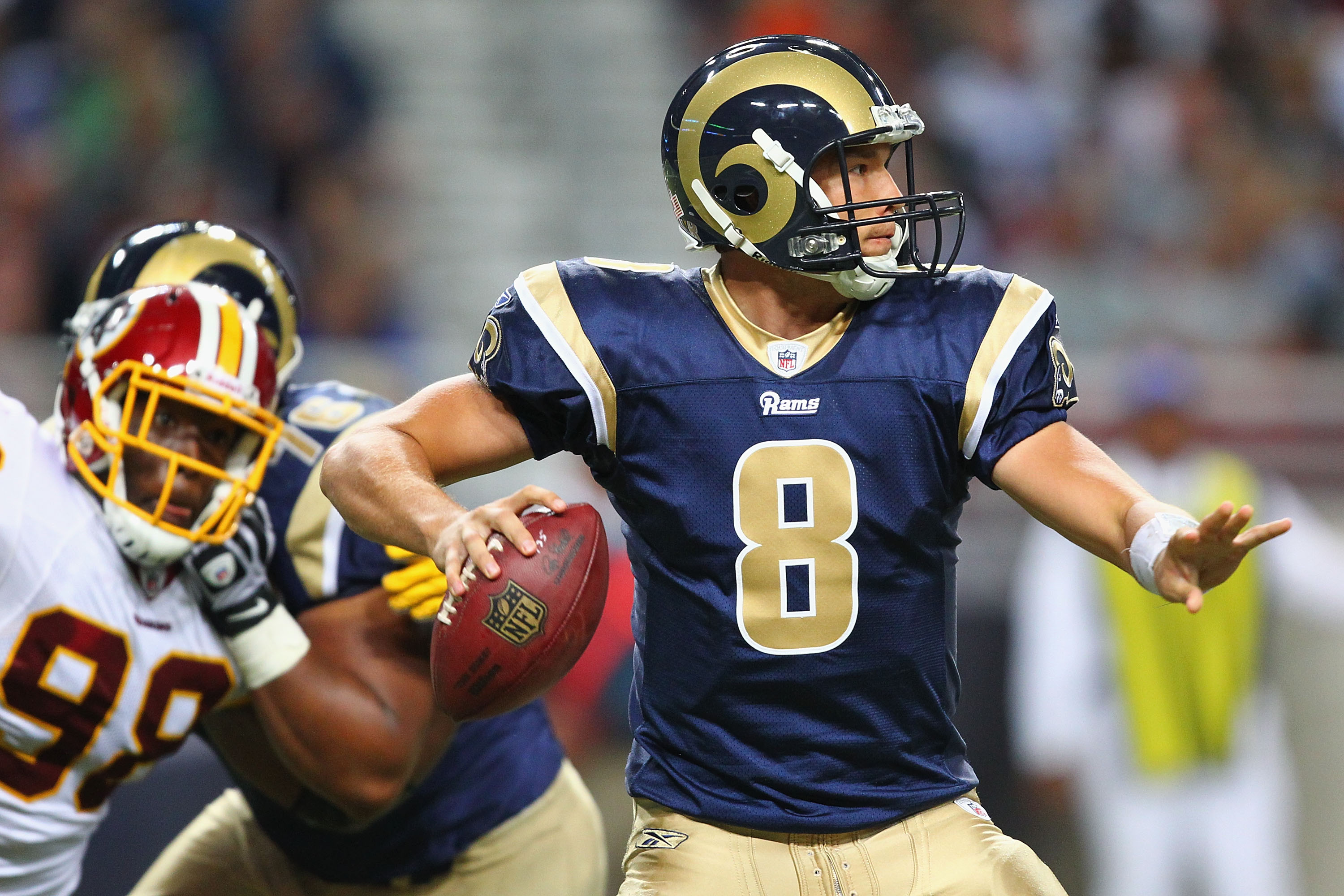 ST. LOUIS - SEPTEMBER 26: Sam Bradford #8 of the St. Louis Rams passes against the Washington Redskins at the Edward Jones Dome on September 26, 2010 in St. Louis, Missouri.  The Rams beat the Redskins 30-16.  (Photo by Dilip Vishwanat/Getty Images)