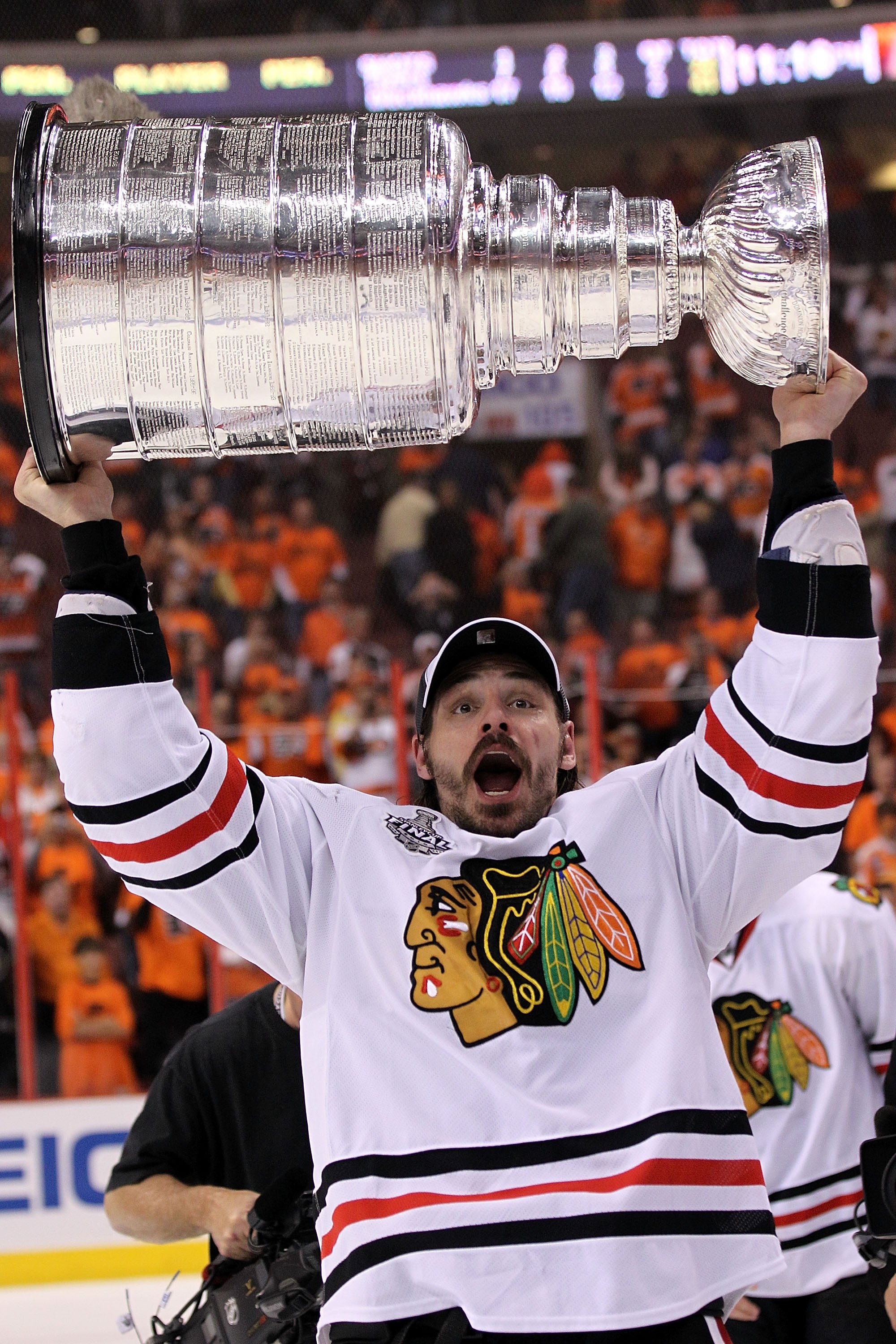 PHILADELPHIA - JUNE 09:  Brent Sopel #5 of the Chicago Blackhawks hoists the Stanley Cup after the Blackhawks defeated the Philadelphia Flyers 4-3 in overtime to win the Stanley Cup in Game Six of the 2010 NHL Stanley Cup Final at the Wachovia Center on J