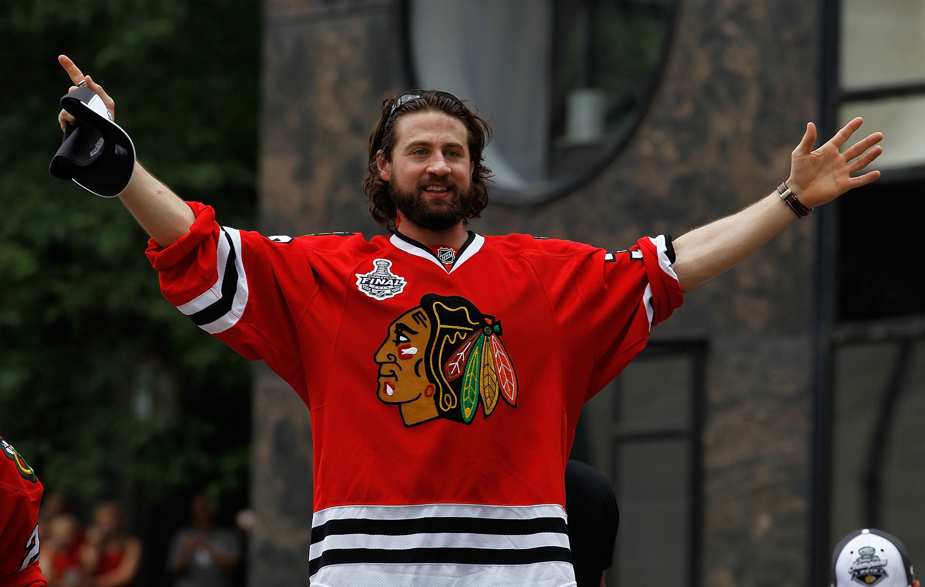 CHICAGO - JUNE 11: Adam Burish #37 waves to fans during the Chicago Blackhawks Stanley Cup victory parade and rally on June 11, 2010 in Chicago, Illinois. (Photo by Jonathan Daniel/Getty Images)