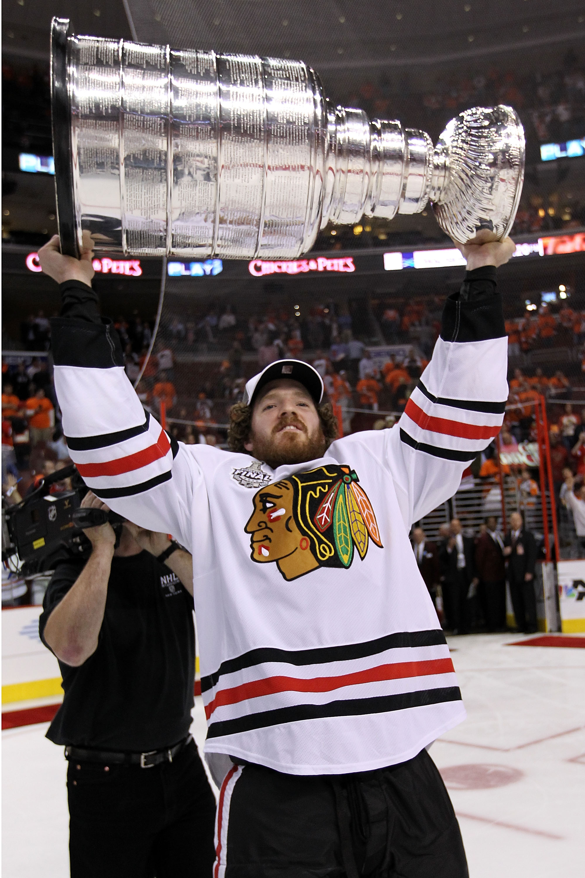 PHILADELPHIA - JUNE 09:  Colin Fraser #46 of the Chicago Blackhawks hoists the Stanley Cup after teammate Patrick Kane #88 scored the game-winning goal in overtime to defeat the Philadelphia Flyers 4-3 and win the Stanley Cup in Game Six of the 2010 NHL S