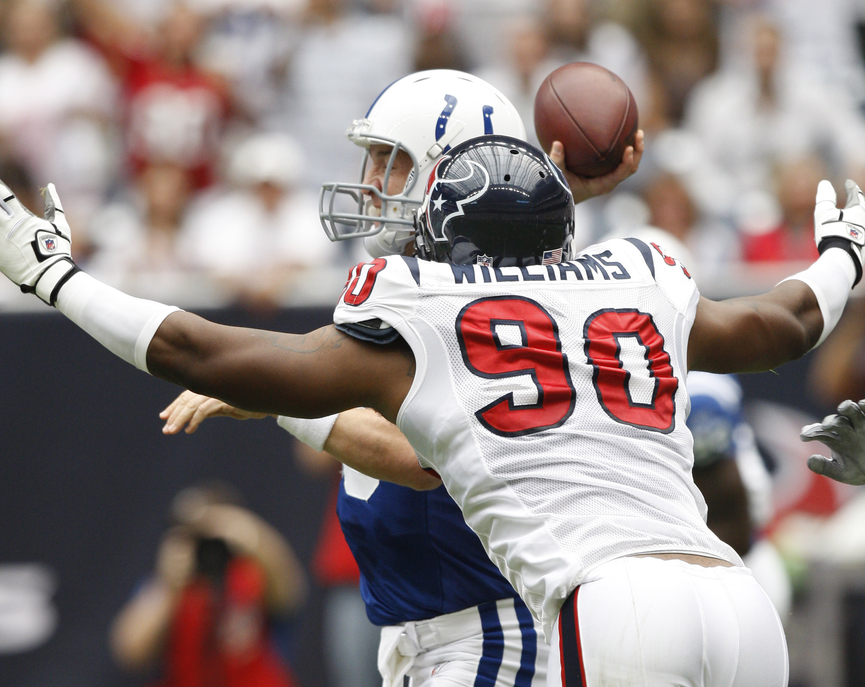 HOUSTON - SEPTEMBER 12:  Defensive end Mario Williams #90 of the Houston Texans applies pressure to quarterback Peyton Manning #18 of the Indianapolis Colts  during the NFL season opener at Reliant Stadium on September 12, 2010 in Houston, Texas.  (Photo
