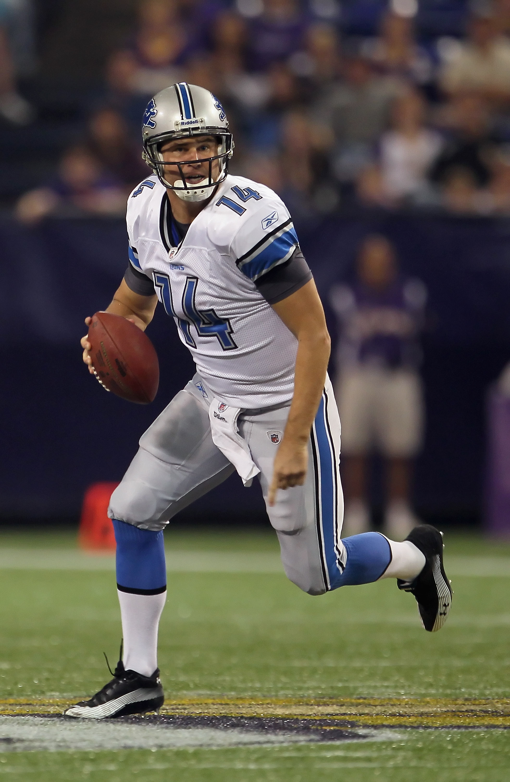 MINNEAPOLIS - SEPTEMBER 26:  Quarterback Shaun Hill #14 of the Detroit Lions scrambles out of the pocket against the Minnesota Vikings during the first half at Hubert H. Humphrey Metrodome on September 26, 2010 in Minneapolis, Minnesota.  (Photo by Jeff G