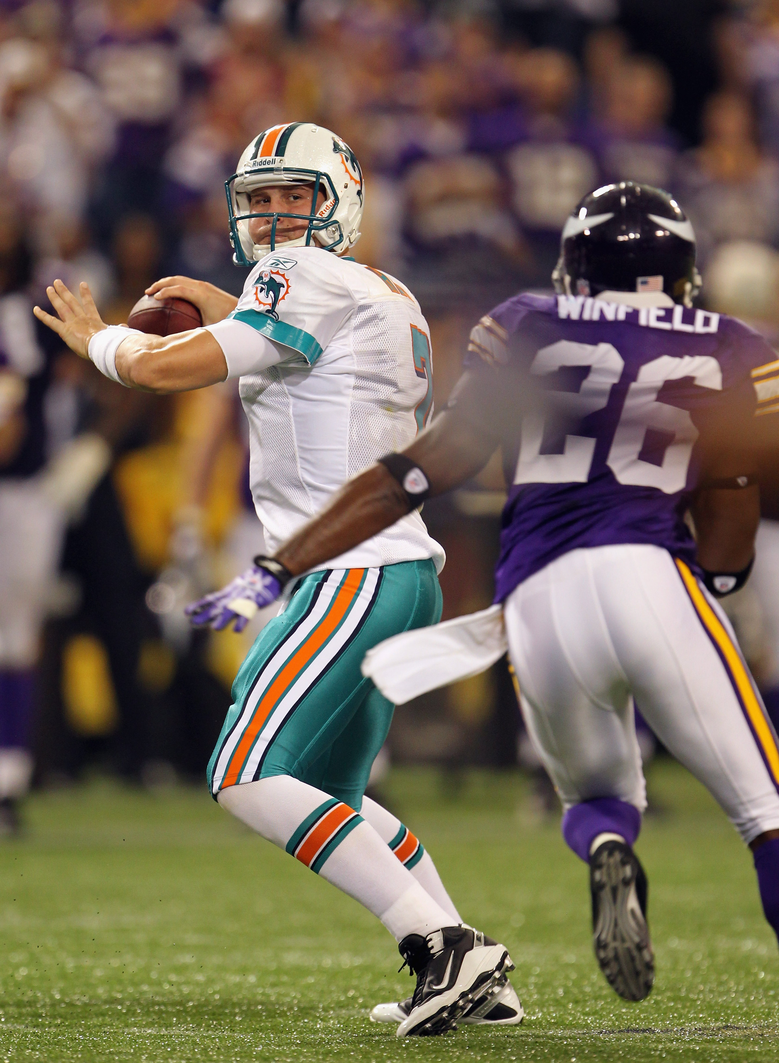 MINNEAPOLIS - SEPTEMBER 19:  Quarterback Chad Henne #7 of the Miami Dolphins passes as Antoine Winfield #26 of the Minnesota Vikings defends during the game on September 19, 2010 at Hubert H. Humphrey Metrodome in Minneapolis, Minnesota.  (Photo by Jamie