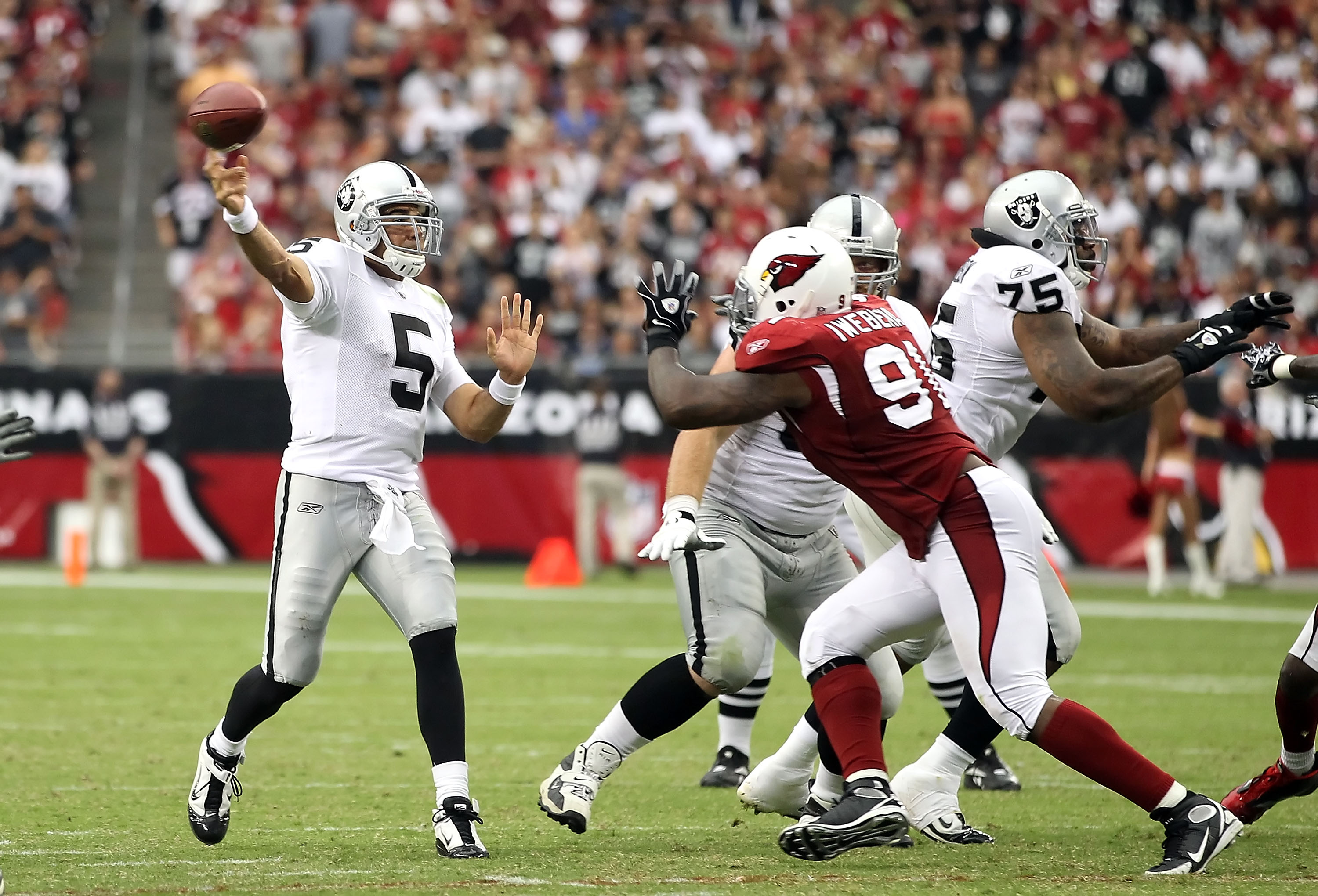 GLENDALE, AZ - SEPTEMBER 26:  Quarterback Bruce Gradkowski #5 of the Oakland Raiders throws a pass during the NFL game against the Arizona Cardinals at the University of Phoenix Stadium on September 26, 2010 in Glendale, Arizona.  The Cardinals defeated t