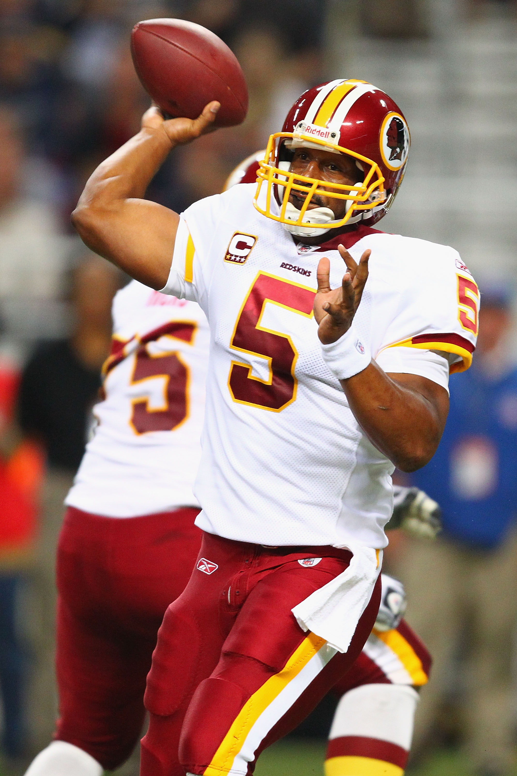 ST. LOUIS - SEPTEMBER 26: Donavan McNabb #5 of the Washington Redskins passes against the St. Louis Rams at the Edward Jones Dome on September 26, 2010 in St. Louis, Missouri.  The Rams beat the Redskins 30-16.  (Photo by Dilip Vishwanat/Getty Images)