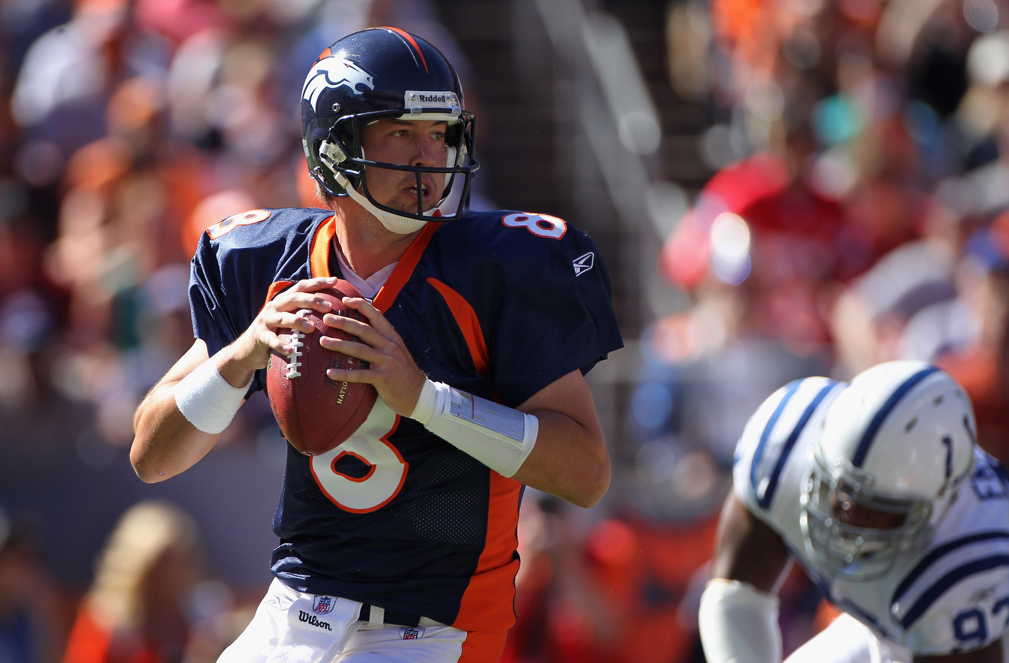 DENVER - SEPTEMBER 26:  Quarterback Kyle Orton #8 of the Denver Broncos delivers a pass against the Indianapolis Colts at INVESCO Field at Mile High on September 26, 2010 in Denver, Colorado. Orton passed for 476 yards as the Colts defeated the Broncos 27