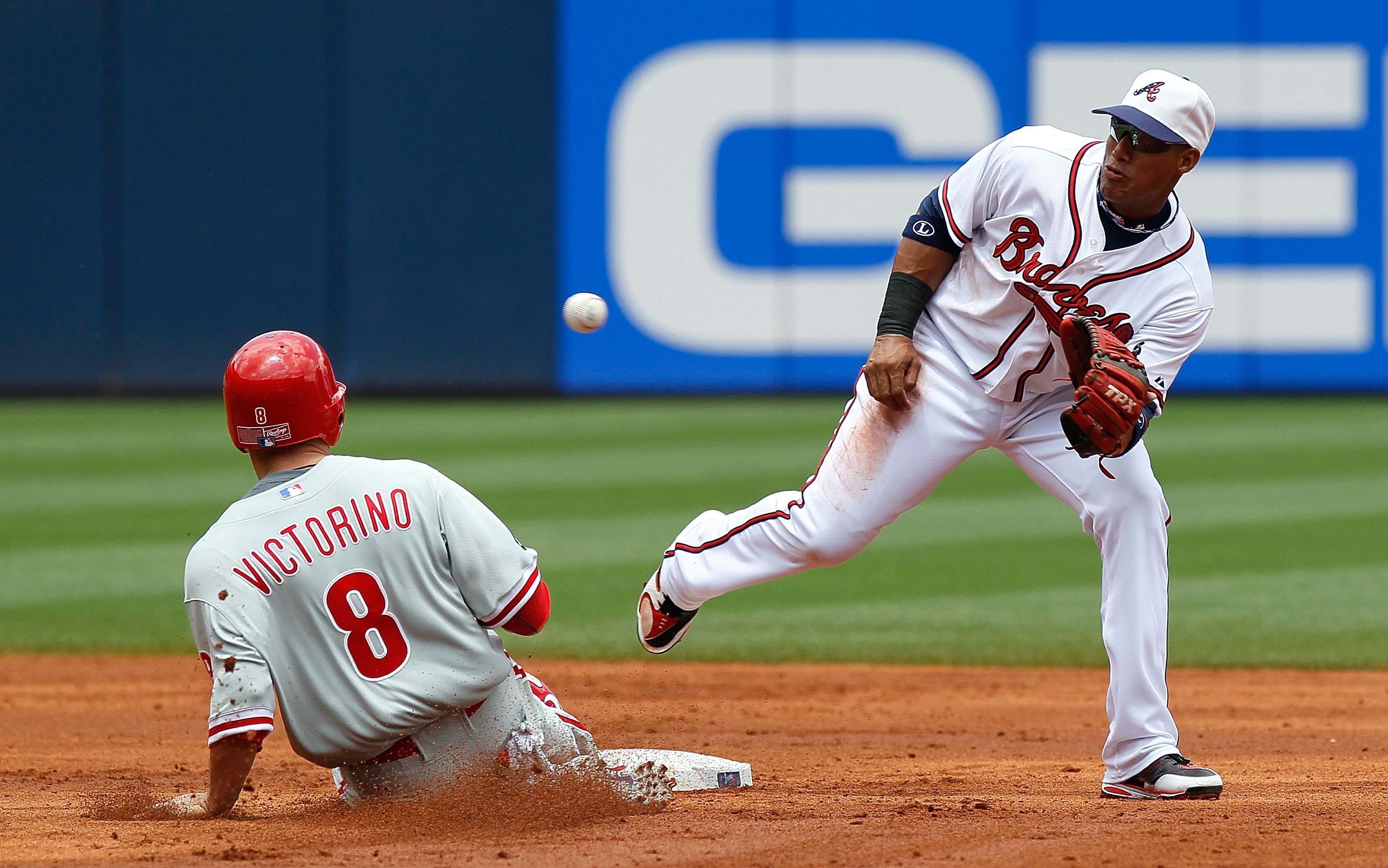 ATLANTA - MAY 31:  Shane Victorino #8 of the Philadelphia Phillies slides safely into second base against Yunel Escobar #19 of the Atlanta Braves at Turner Field on May 31, 2010 in Atlanta, Georgia.  (Photo by Kevin C. Cox/Getty Images)