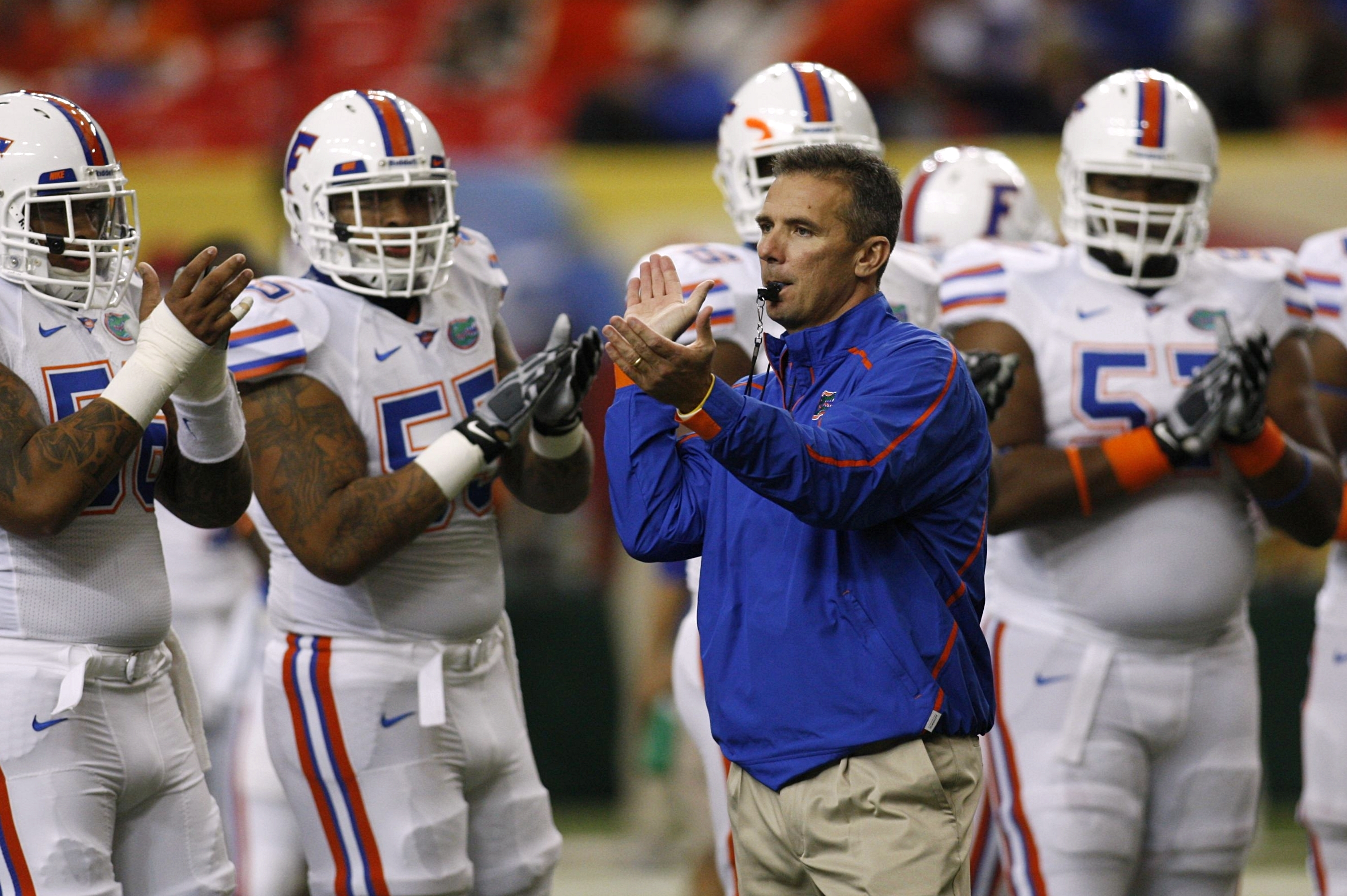 ATLANTA - DECEMBER 5:  Head coach Urban Meyer of the Florida Gators encourages his players during warm ups against the Alabama Crimson Tide during the SEC Championship game at Georgia Dome on December 5, 2009 in Atlanta, Georgia.  (Photo by Chris Graythen