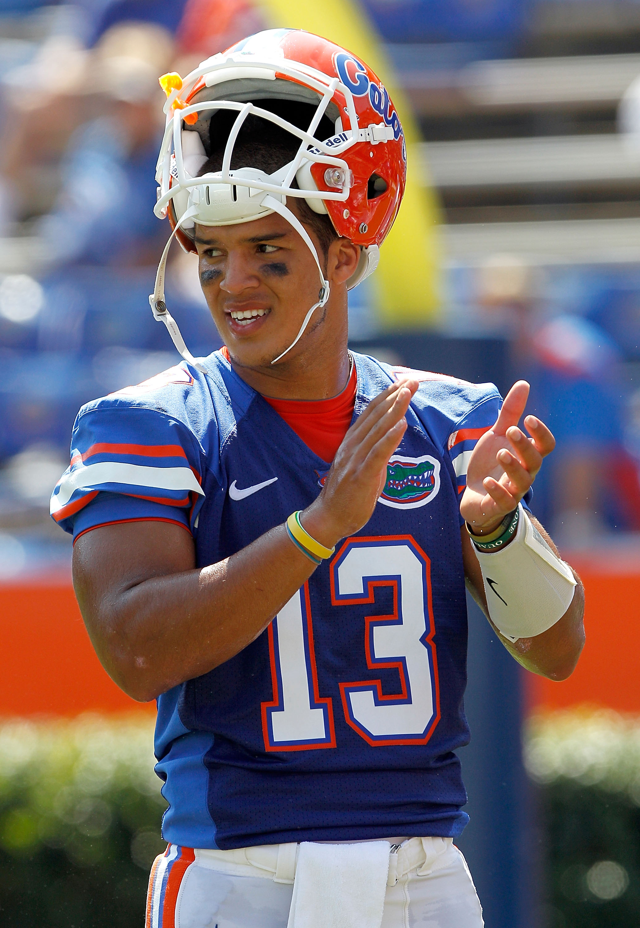 GAINESVILLE, FL - SEPTEMBER 11:  Quarterback Trey Burton #13 of the Florida Gators claps prior to a game against the South Florida Bulls at Ben Hill Griffin Stadium on September 11, 2010 in Gainesville, Florida.  (Photo by Sam Greenwood/Getty Images)