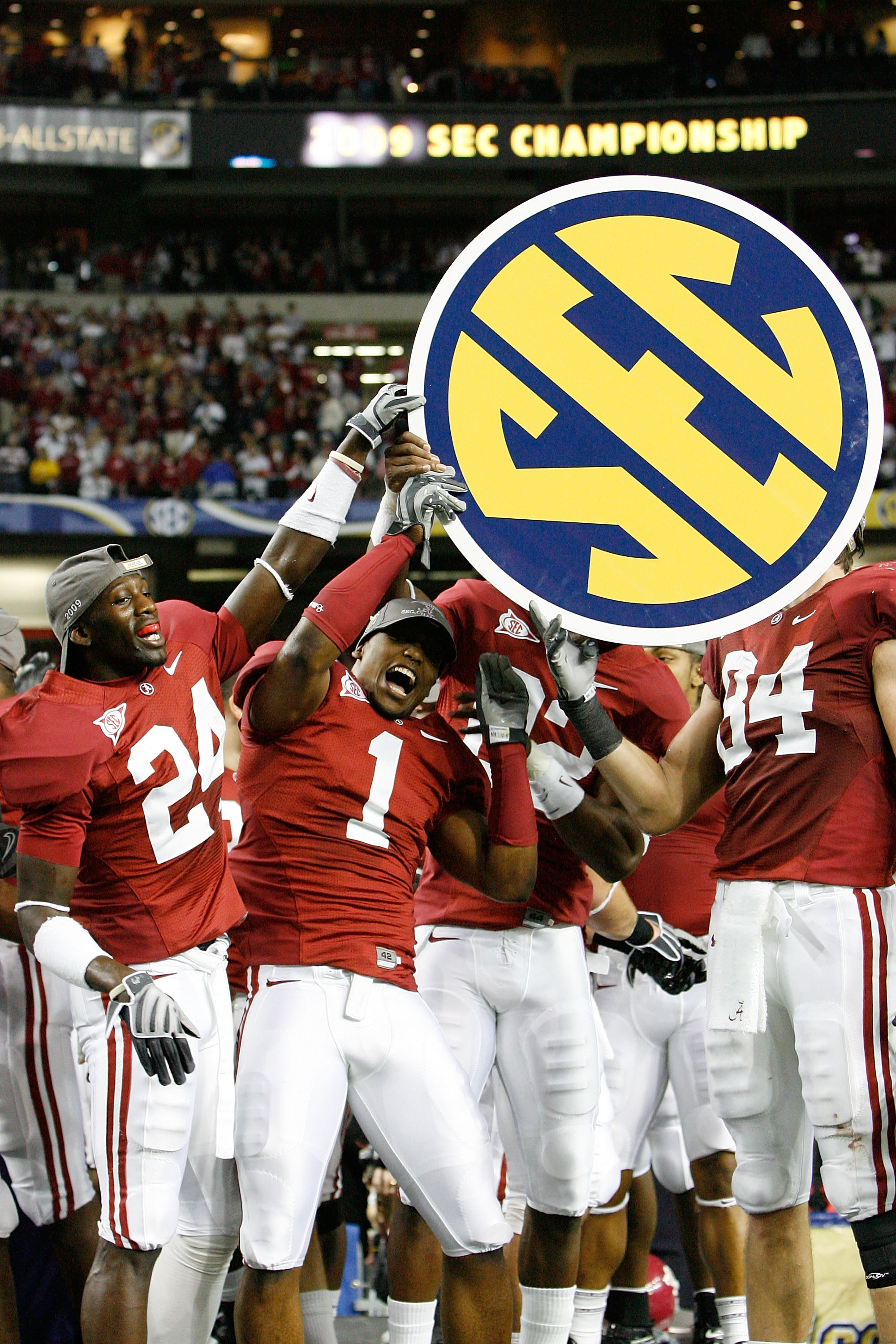 ATLANTA - DECEMBER 05:  Members of the Alabama Crimson Tide celebrate after defeating the Florida Gators 31-13 during the SEC Championship at the Georgia Dome on December 5, 2009 in Atlanta, Georgia.  (Photo by Chris Graythen/Getty Images)