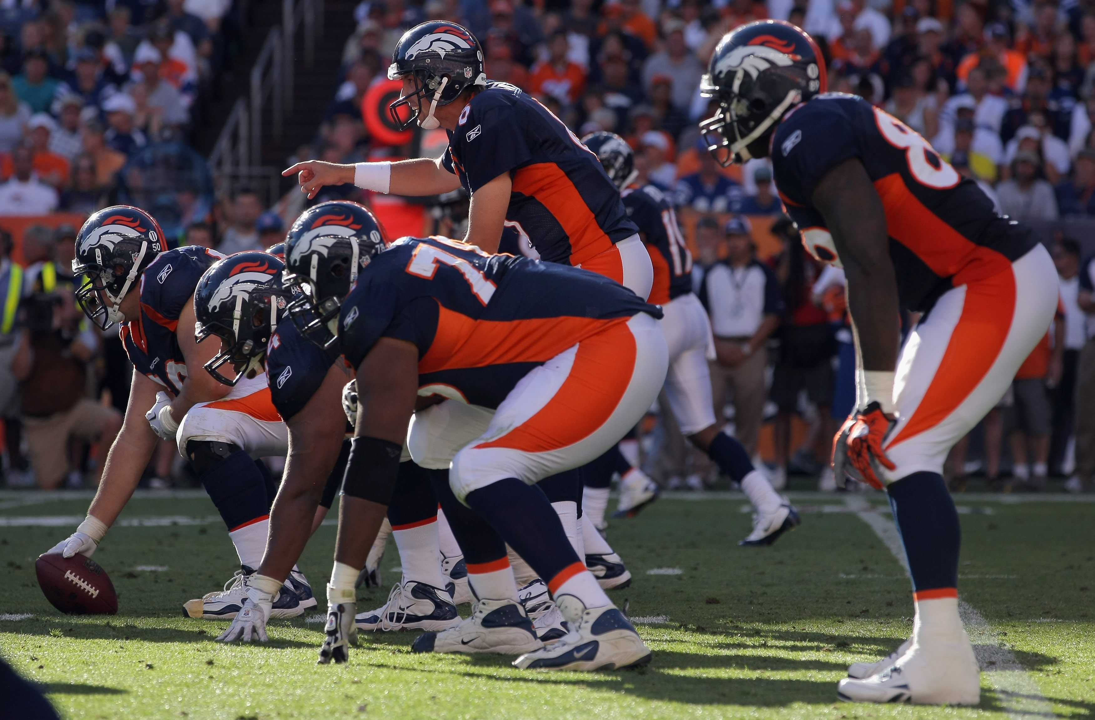 DENVER - SEPTEMBER 26:  Quarterback Kyle Orton #8 of the Denver Broncos runs the offense against the Indianapolis Colts at INVESCO Field at Mile High on September 26, 2010 in Denver, Colorado. Orton passed for 476 yards as the Colts defeated the Broncos 2