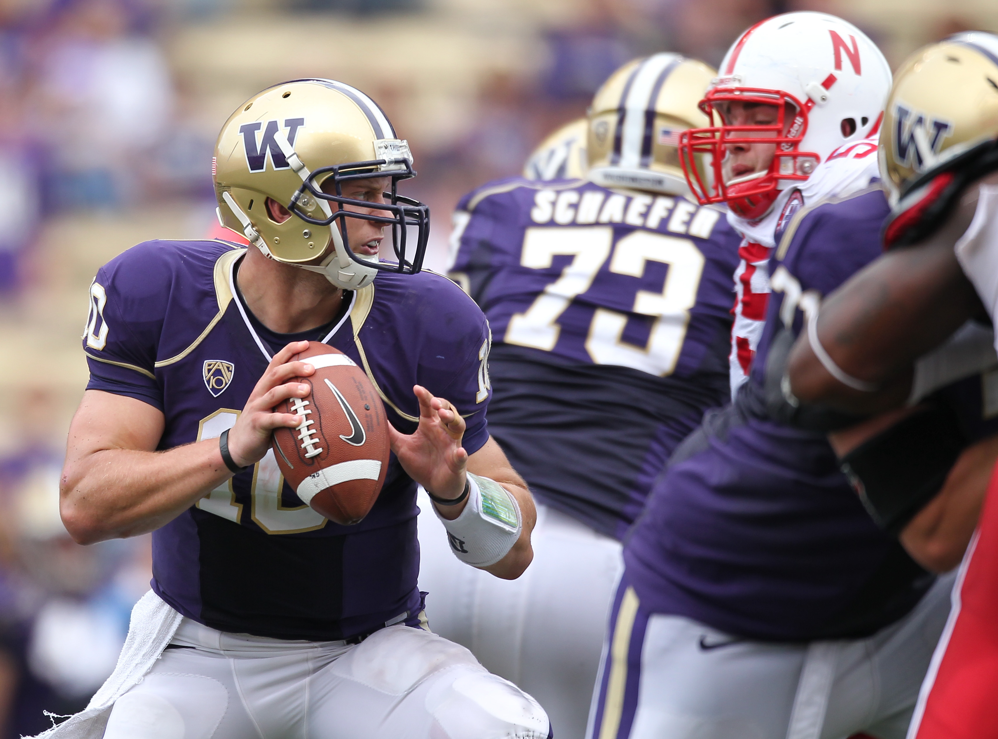 SEATTLE - SEPTEMBER 18: Quarterback Jake Locker #10 of the Washington Huskies looks downfield against the Nebraska Cornhuskers on September 18, 2010 at Husky Stadium in Seattle, Washington. (Photo by Otto Greule Jr/Getty Images)