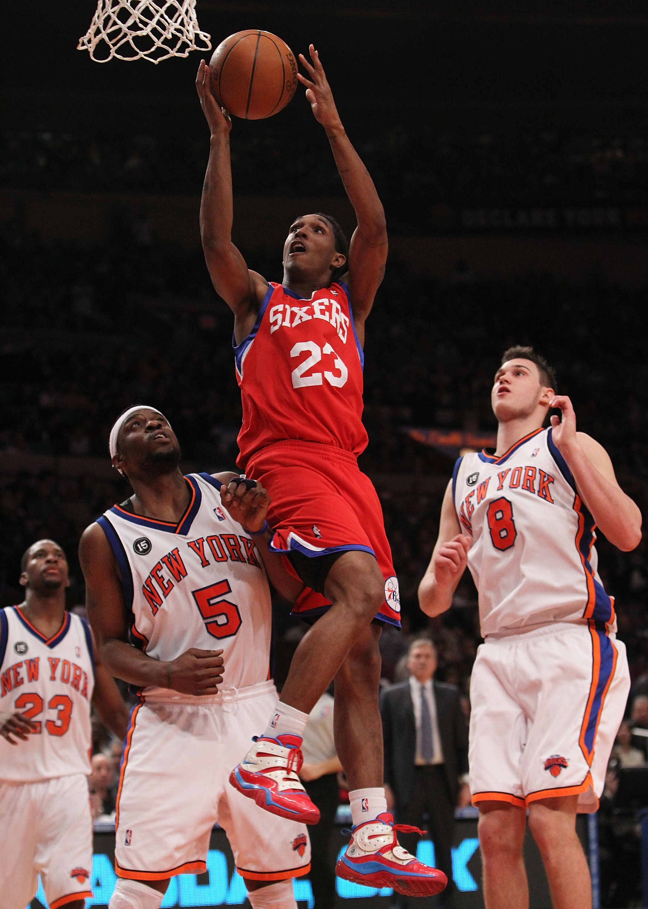 NEW YORK - MARCH 19:  Louis Williams #23 of the Philadelphia 76ers lays the ball up in between Bill Walker #5 and Danilo Gallinari #8 of the New York Knicks at Madison Square Garden on March 19, 2010 in New York City. NOTE TO USER: User expressly acknowle