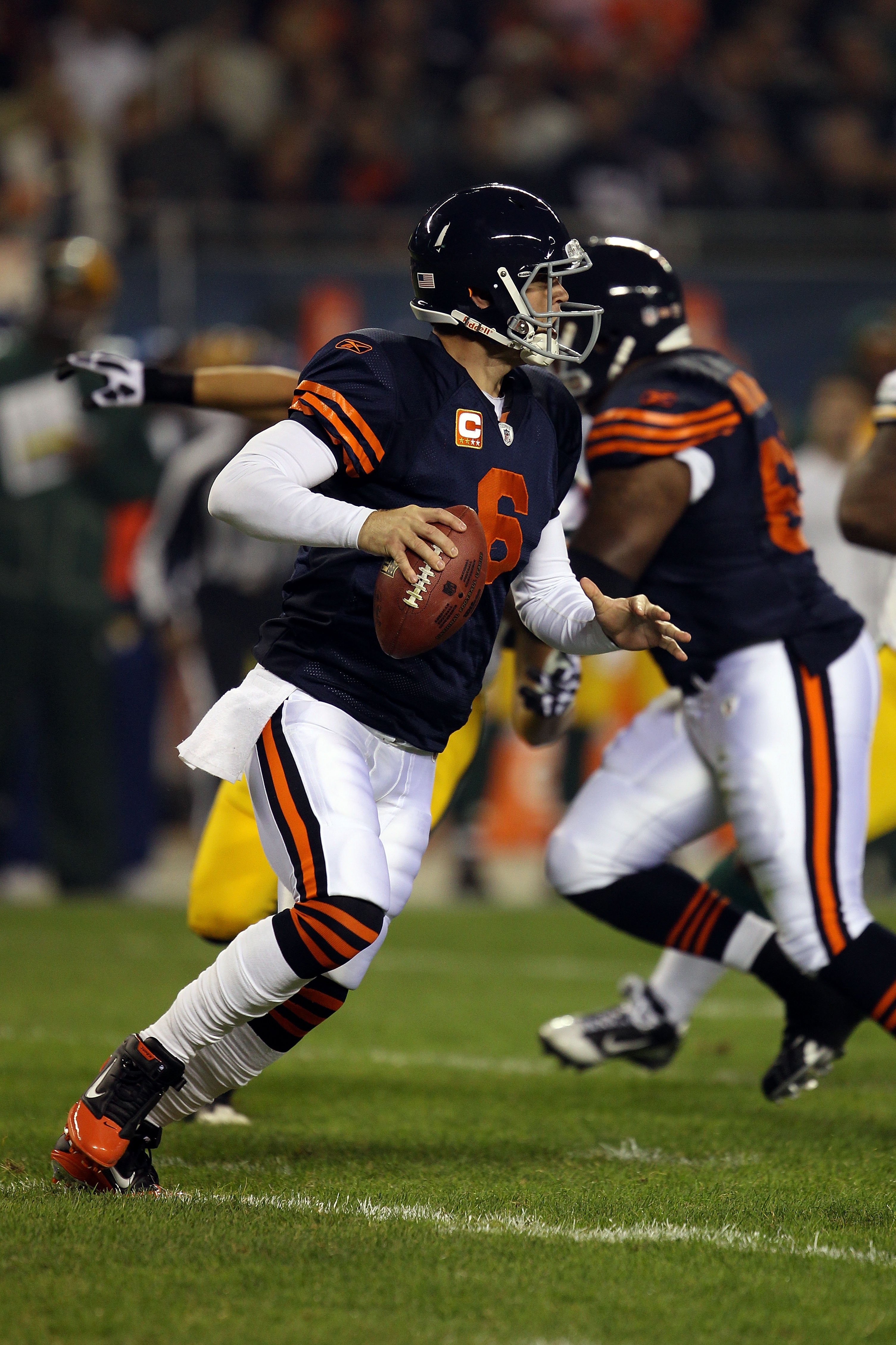 CHICAGO - SEPTEMBER 27:  Jay Cutler #6 of the Chicago Bears rolls out to pass against the Green Bay Packers at Soldier Field on September 27, 2010 in Chicago, Illinois. The Bears won 20-17.  (Photo by Jonathan Daniel/Getty Images)