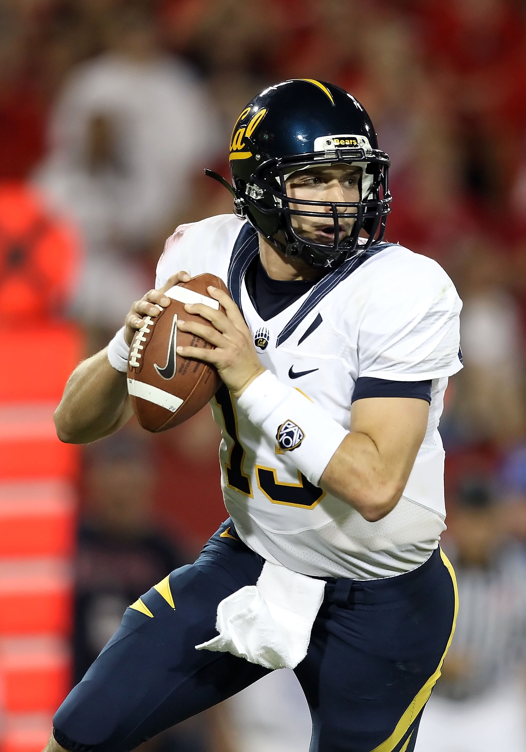 TUCSON, AZ - SEPTEMBER 25:  Quarterback Kevin Riley #13 of the California Golden Bears drops back to pass during the college football game against the Arizona Wildcats at Arizona Stadium on September 25, 2010 in Tucson, Arizona. The Wildcats defeated the