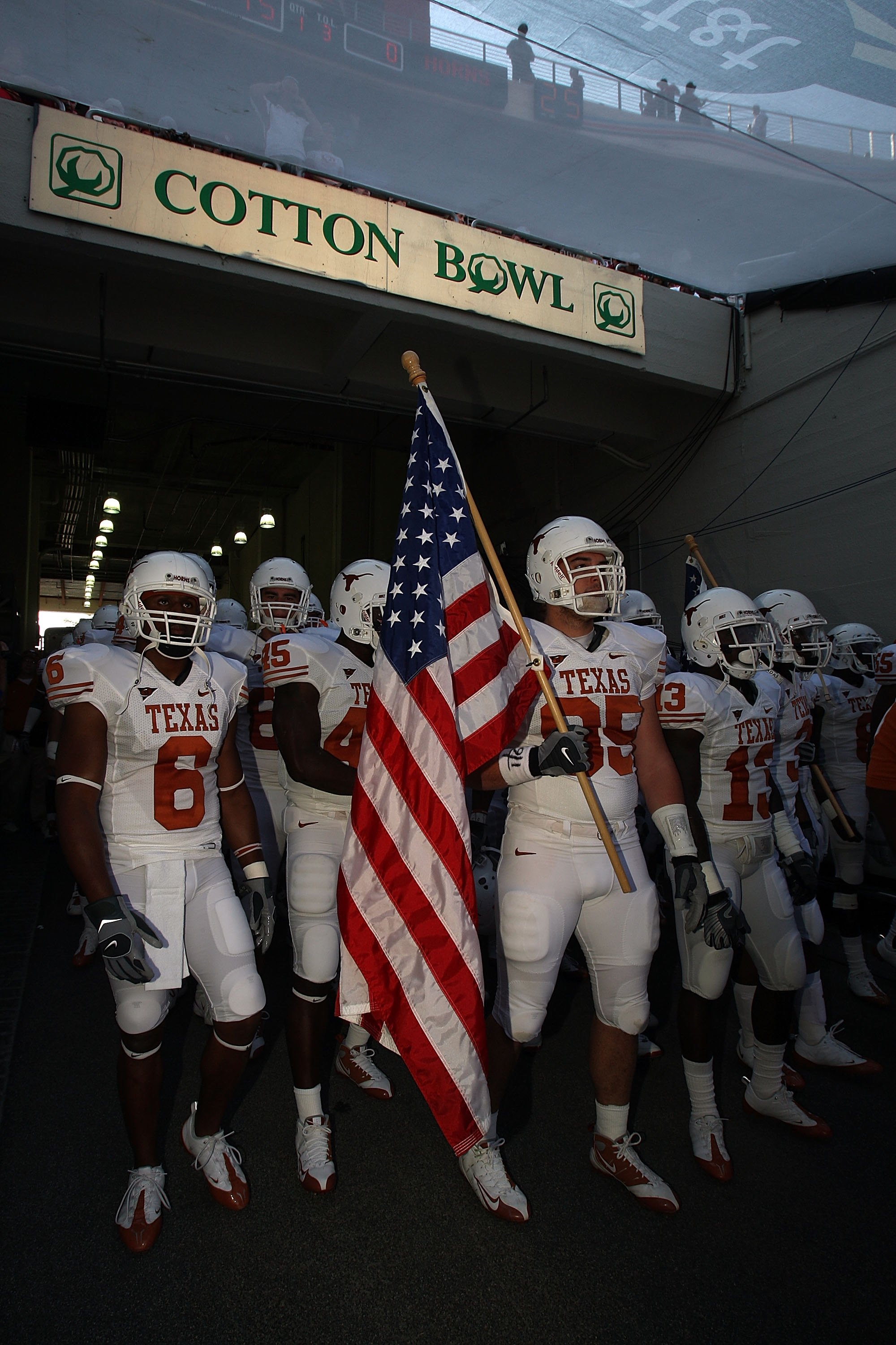 DALLAS - OCTOBER 11:  Defensive end Aaron Lewis #95 the Texas Longhorns carries an enters the field before the Red River Rivalry game against the Oklahoma Sooners at the Cotton Bowl on October 11, 2008 in Dallas, Texas.  (Photo by Ronald Martinez/Getty Im