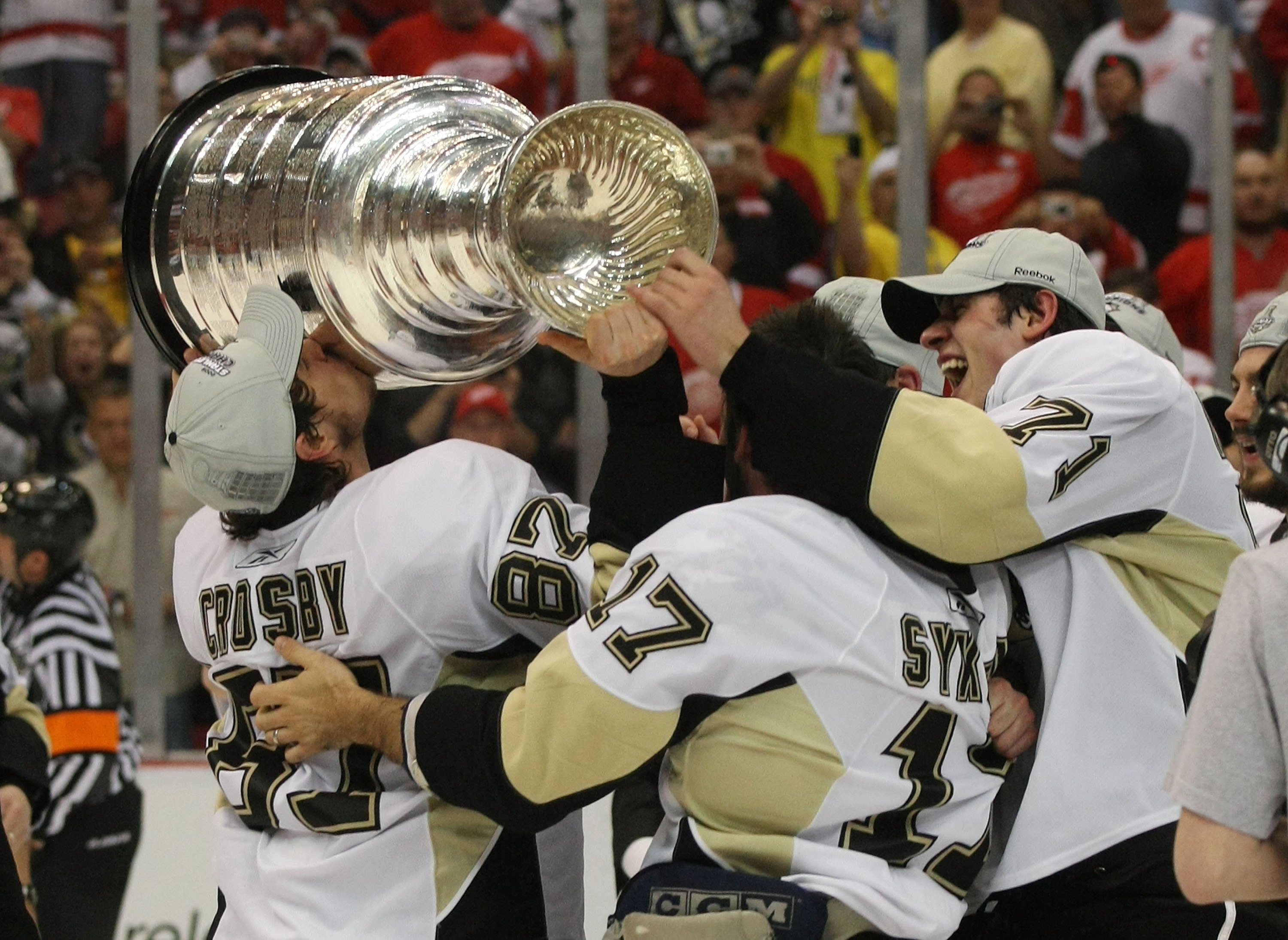 DETROIT - JUNE 12: (L-R) Sideny Crosby #87, Petr Sykora #17 and Evgeni Malkin #71 of the Pittsburgh Penguins hold  the Stanley Cup following the Penguins victory over the Detroit Red Wings in Game Seven of the 2009 NHL Stanley Cup Finals at Joe Louis Aren
