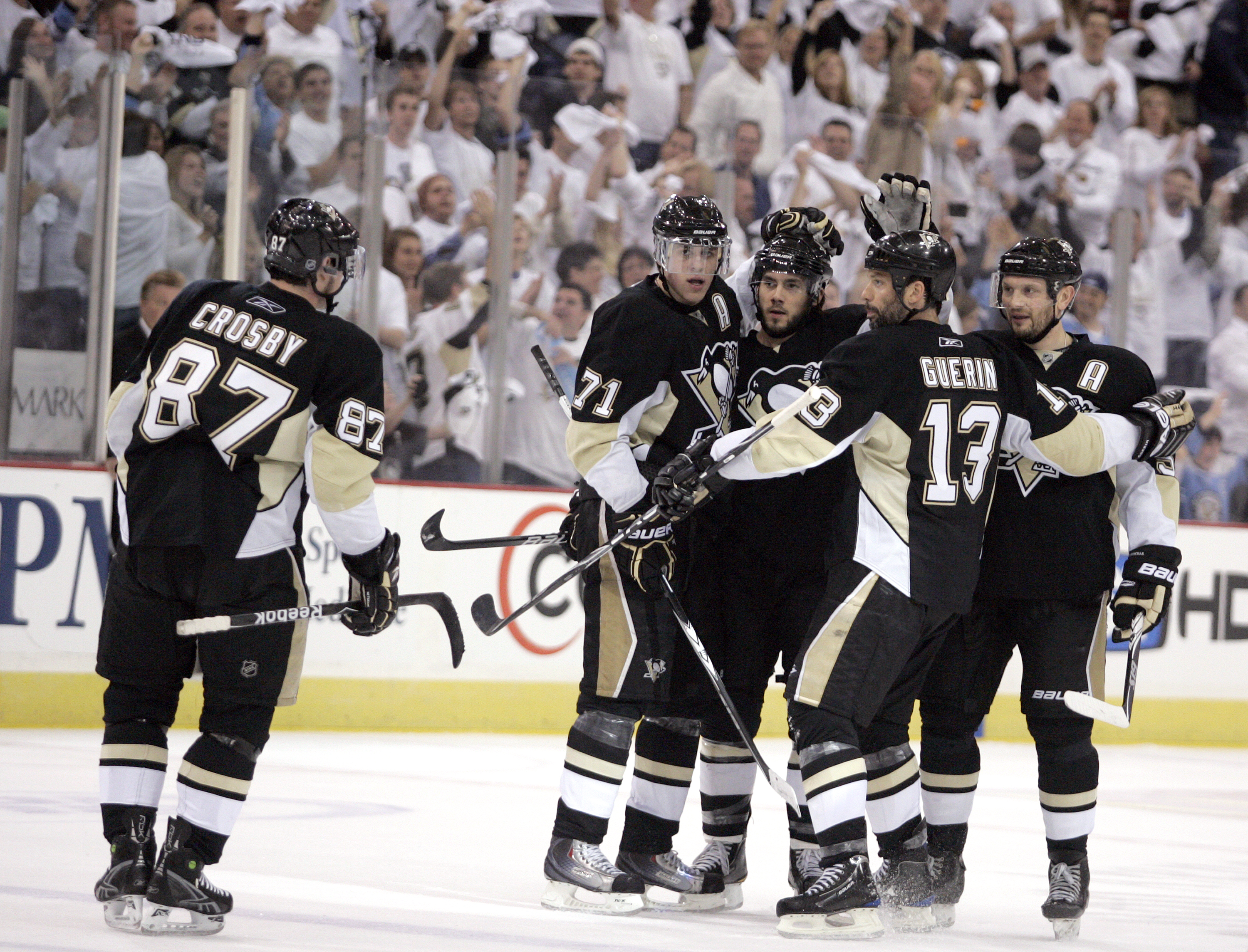 PITTSBURGH - MAY 8:  Kris Letang #58 of the Pittsburgh Penguins celebrates his power play goal with teammates agains the Montreal Canadiens in Game Five of the Eastern Conference Semifinals during the 2010 NHL Stanley Cup Playoffs at Mellon Arena on May 8
