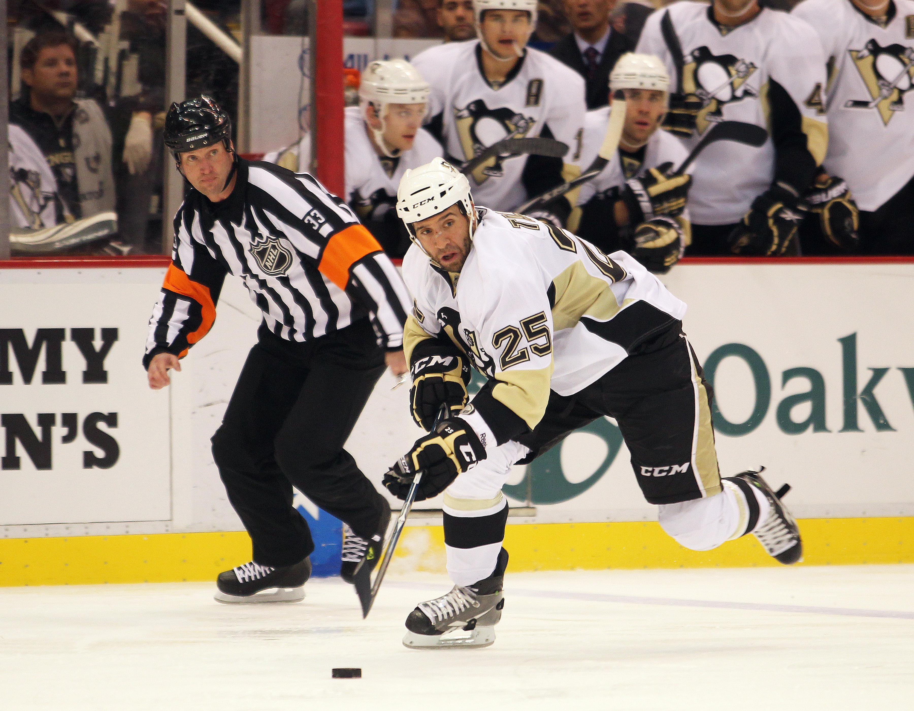 DETROIT, MI - OCTOBER 03:  Max Talbot #25 of the Pittsburgh Penguins skates in on a break in a preseason game against the Detroit Red Wings on October 3, 2010 at the Joe Louis Arena in Detroit, Michigan. The Penguins defeated the Red Wings 5-2. (Photo by