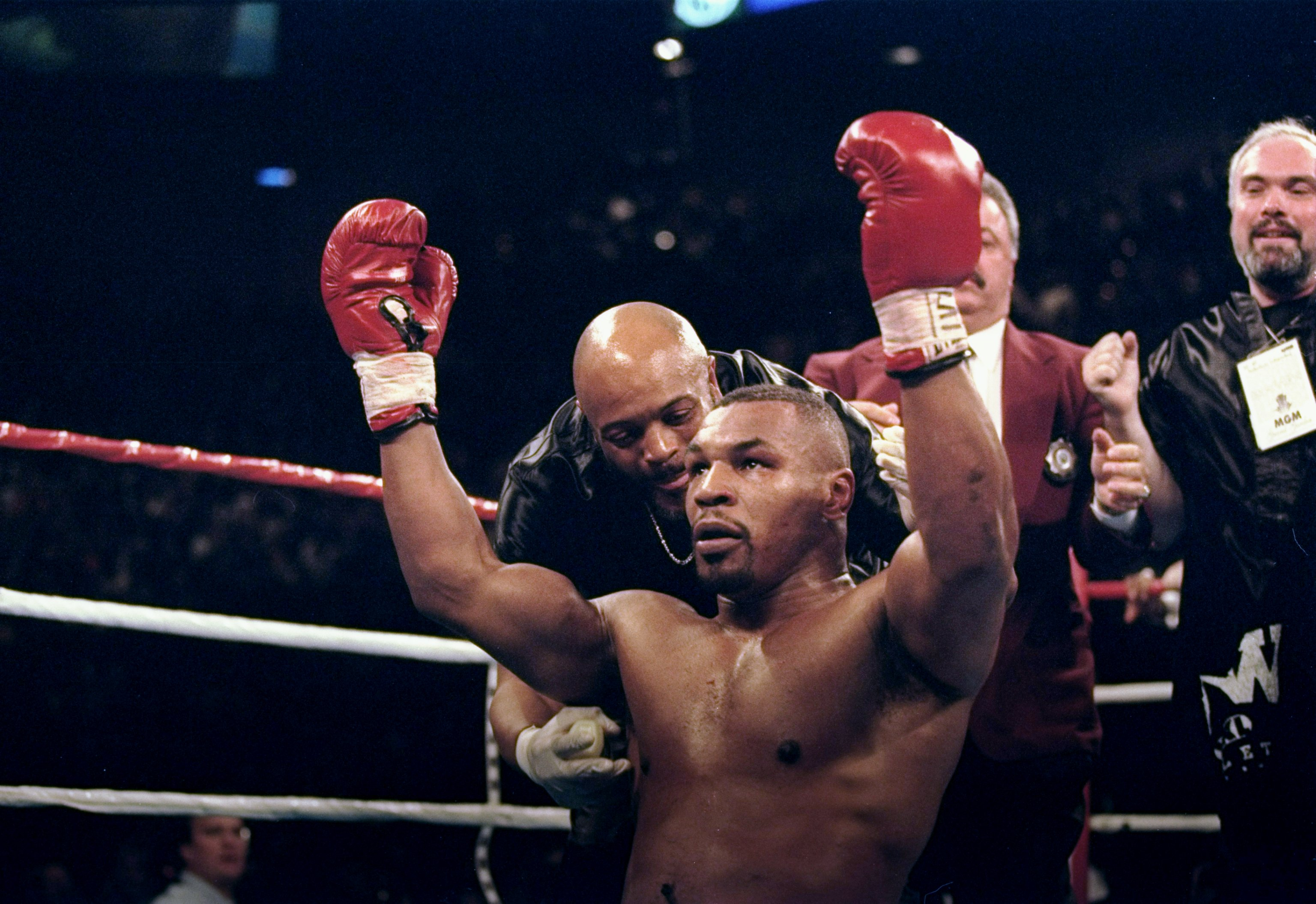 16 Mar 1996:  Mike Tyson falls to his knees in celebration after knocking out Frank Bruno of Great Britain in the third round of the WBC Heavyweight Championship bout at the MGM Grand Garden in Las Vegas, Nevada. Mandatory Credit: Al Bello  /Allsport