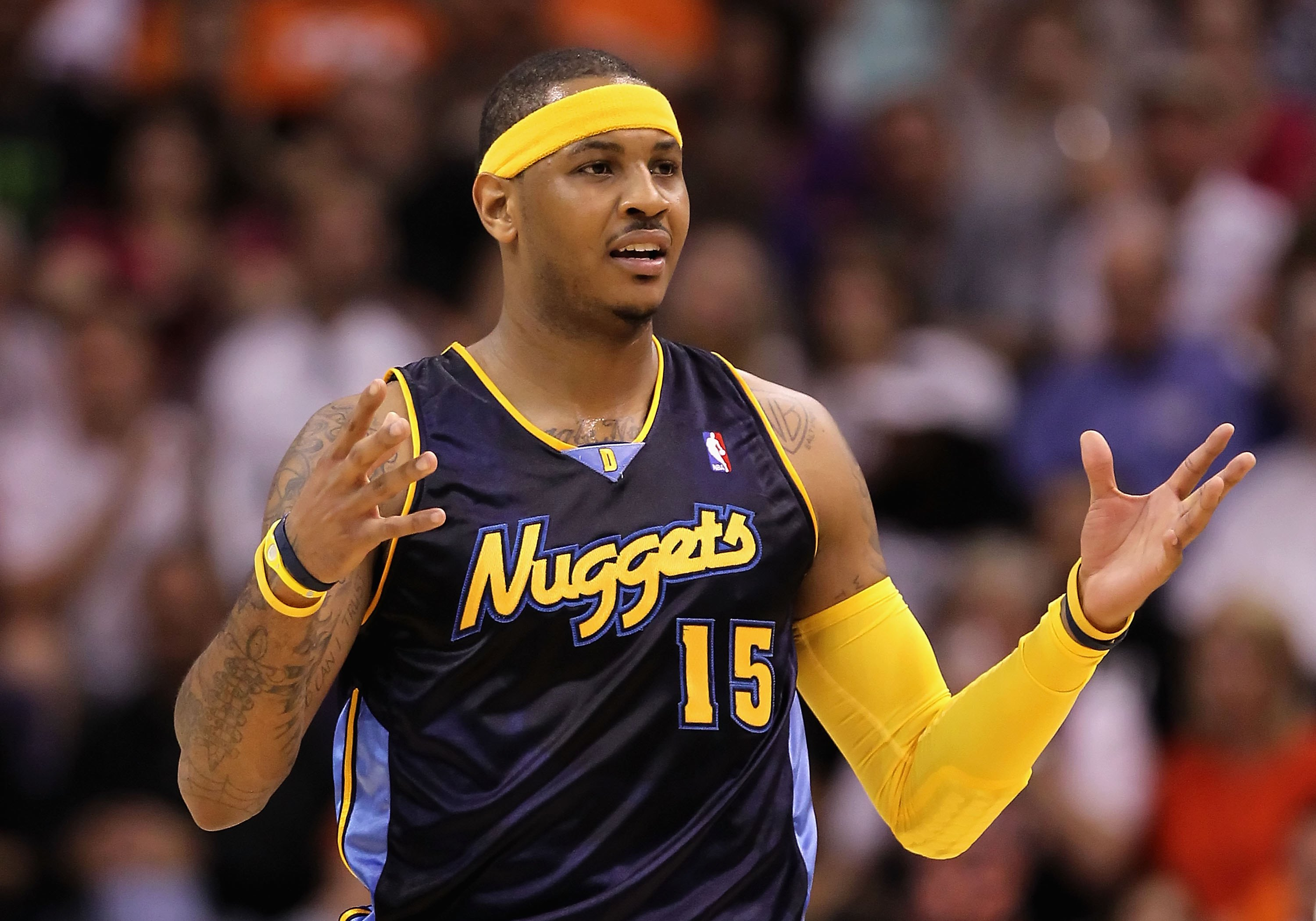 480d50abb48 PHOENIX - APRIL 13  Carmelo Anthony  15 of the Denver Nuggets reacts during  the