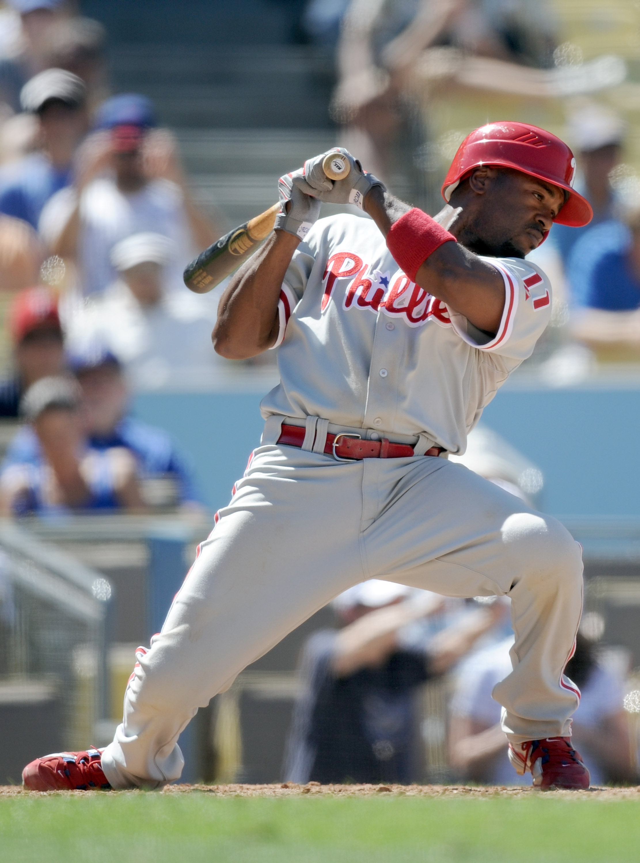 LOS ANGELES, CA - SEPTEMBER 01:  Jimmy Rollins #11 of the Philadelphia Phillies ducks a pitch against the Los Angeles Dodgers at Dodger Stadium on September 1, 2010 in Los Angeles, California.  (Photo by Harry How/Getty Images)