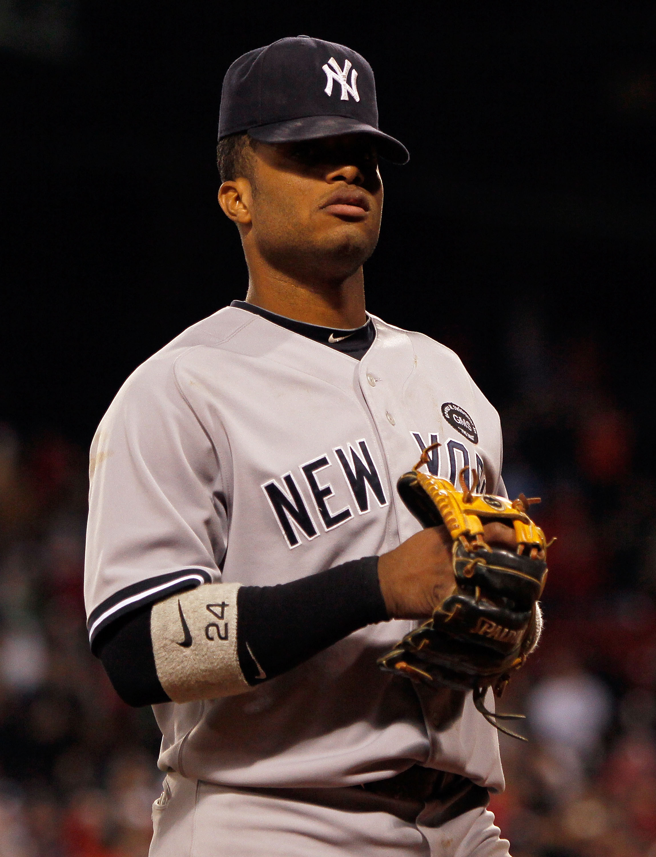 BOSTON - OCTOBER 2:  Robinson Cano #24 of the New York Yankees leaves the field after teammate Ivan Nova allowed a hit to Eric Petterson #3 of the Boston Red Sox in the tenth inning, which knocked in the winning run, in the second game of a doubleheader a