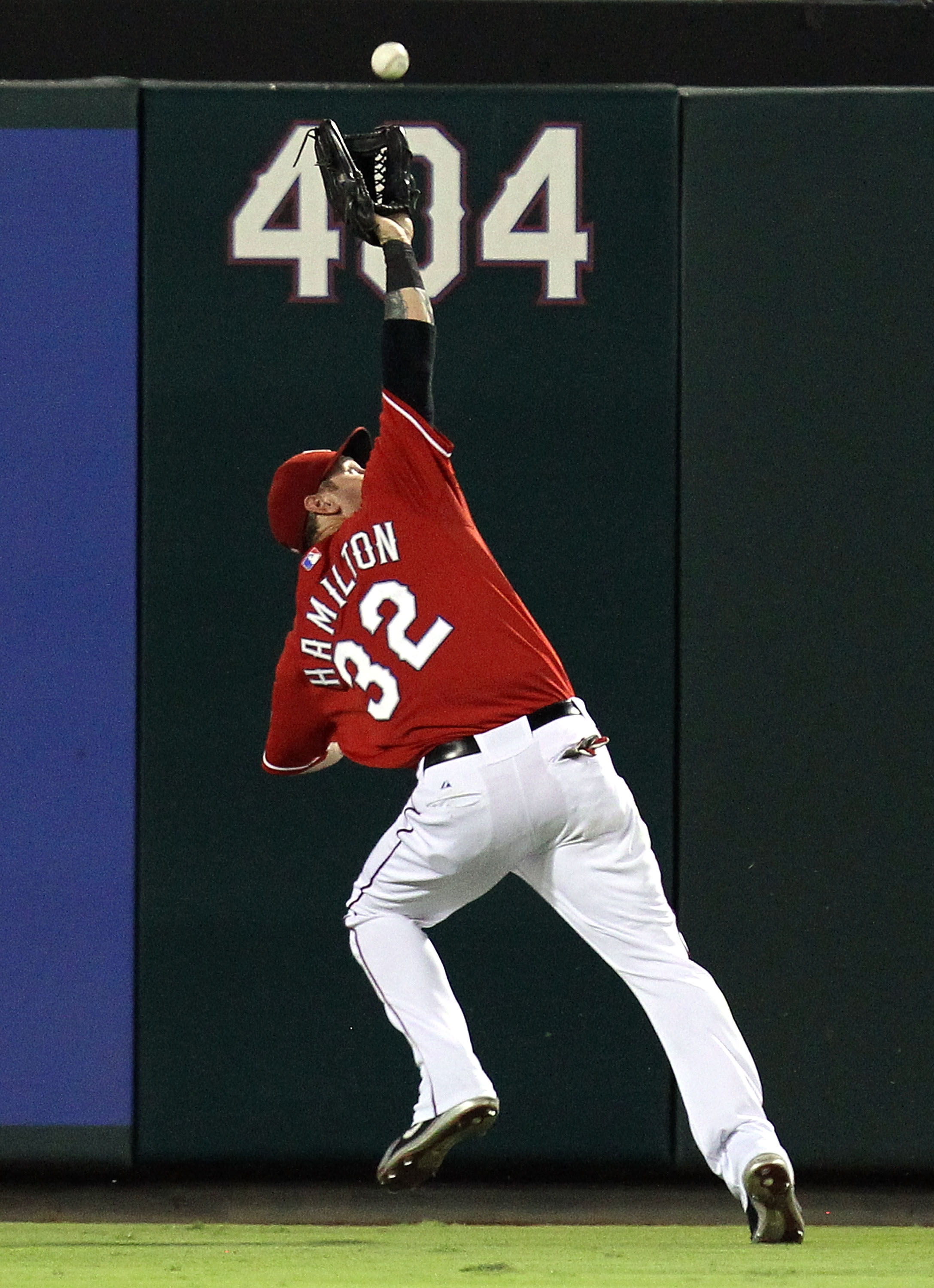 ARLINGTON, TX - OCTOBER 01:  Left fielder Josh Hamilton #32 of the Texas Rangers makes the fly out against Torii Hunter #48 of the Los Angeles Angels of Anaheim at Rangers Ballpark in Arlington on October 1, 2010 in Arlington, Texas.  (Photo by Ronald Mar