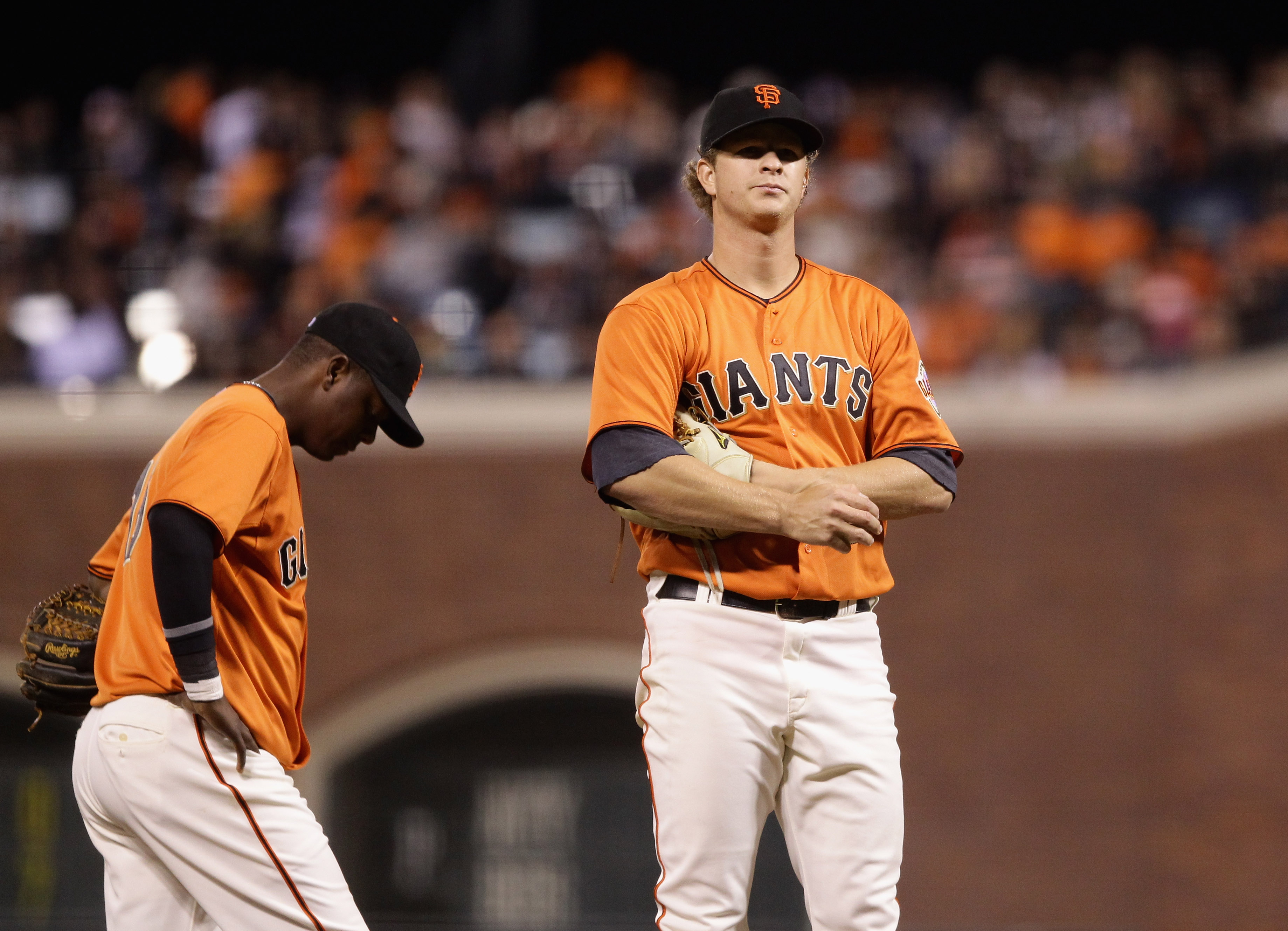 SAN FRANCISCO - OCTOBER 01:  Matt Cain #18 and Edgar Renteria #16 of the San Francisco Giants wait for manager Bruce Bochy to come to the mound to take Cain out of their game against the San Diego Padres in the fifth inning at AT&T Park on October 1, 2010